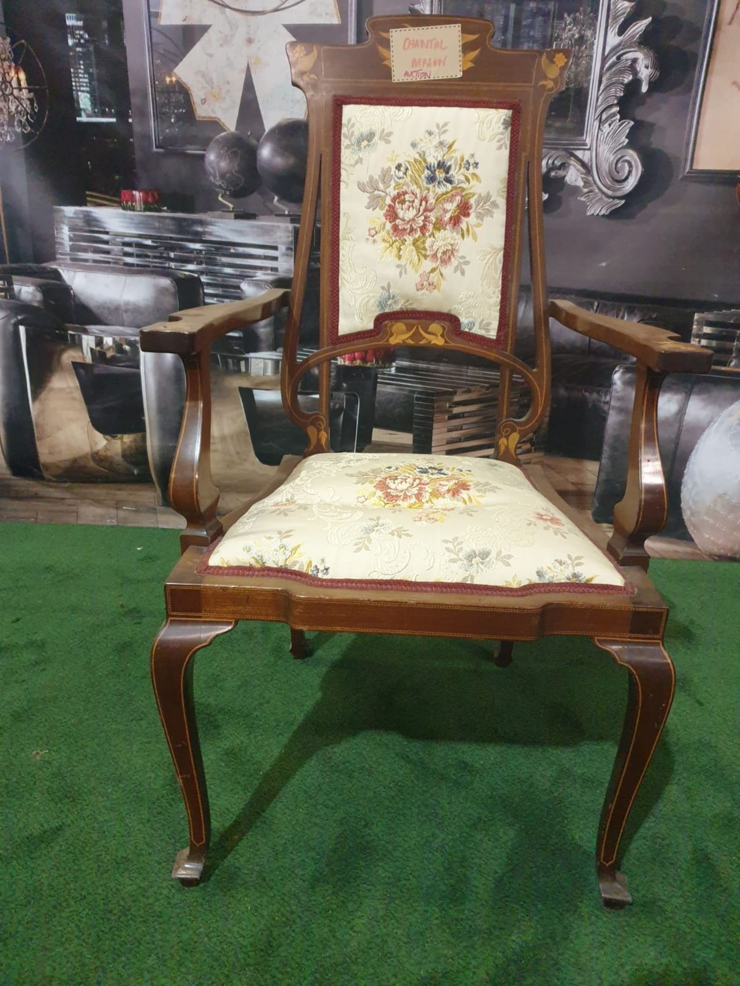 A mahogany and marquetry armchair.The flower and leaf-inlaid shaped toprail above an oblong padded - Image 3 of 5