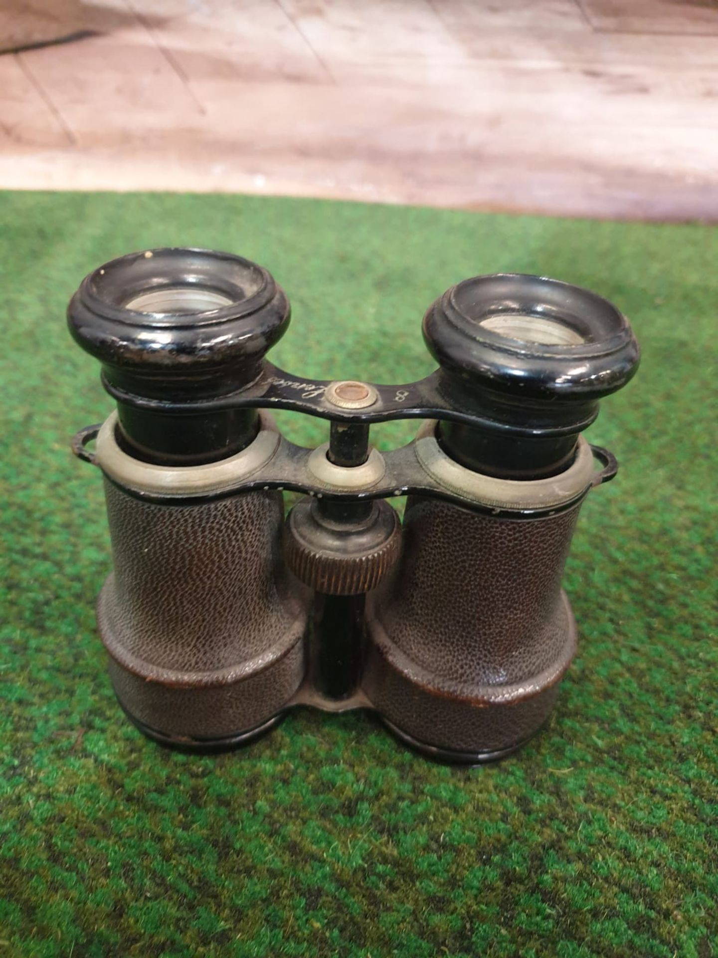 A Pair of vintage binoculars with black leather covered casing and black enamel trim, a compass is - Image 4 of 5