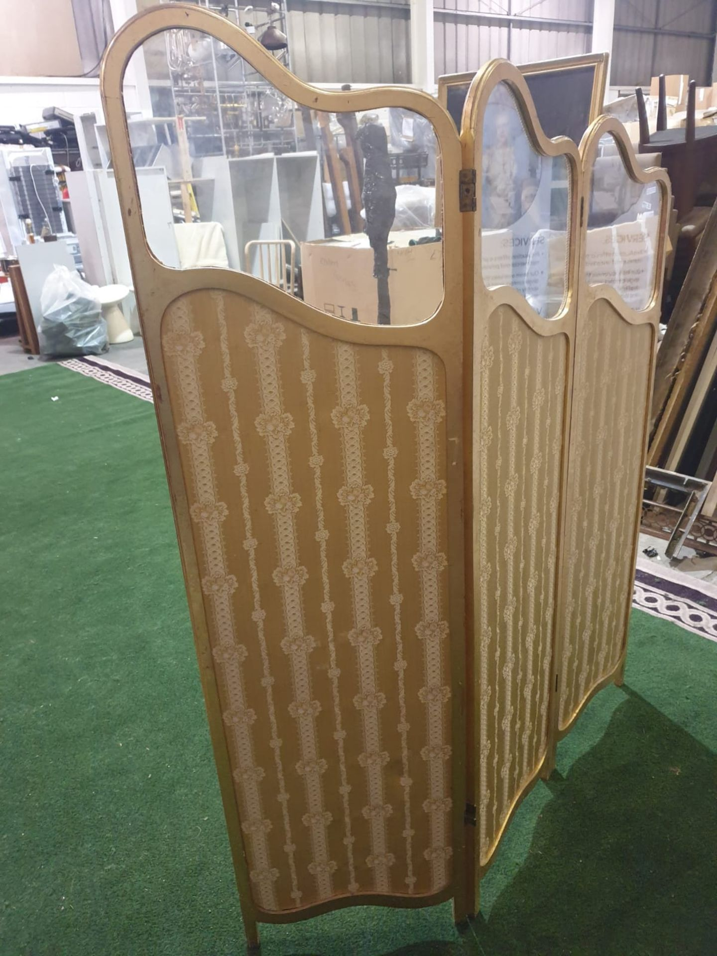 A giltwood and upholstered screen.The three graduated panels with glazed upper panels over damask- - Image 2 of 3
