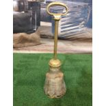 A Victorian brass mounted horse's hoof door stop.The hoof mounted with brass with a ring handle
