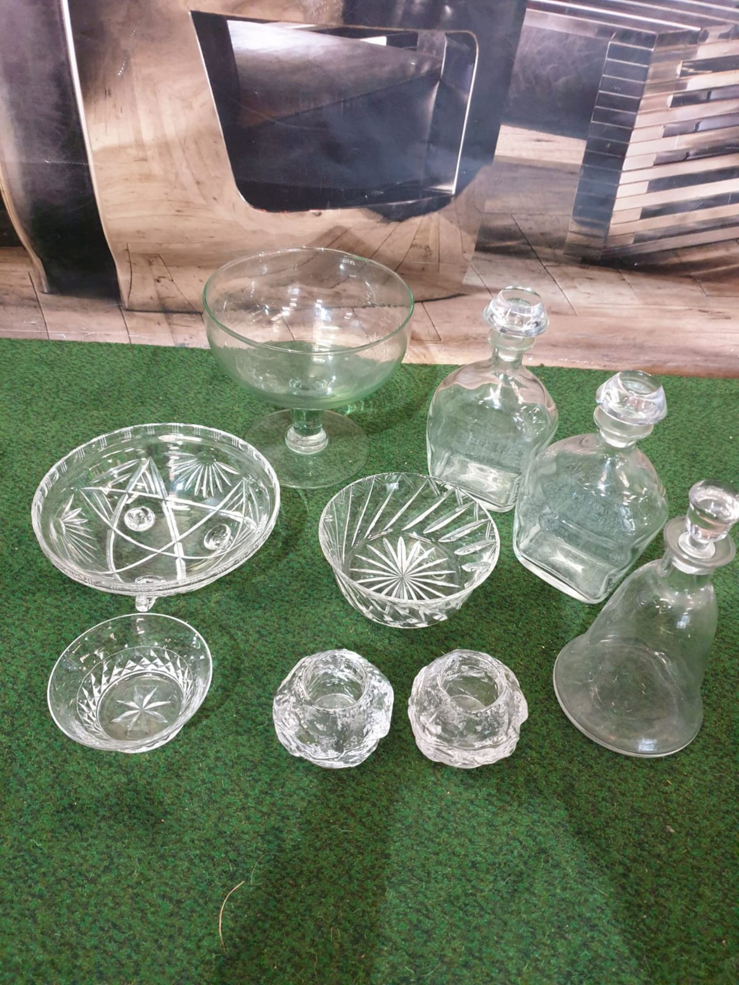 A set of 3 clear glass decanters with pillar neck each fitted with a stoppers. Circa early 20c
