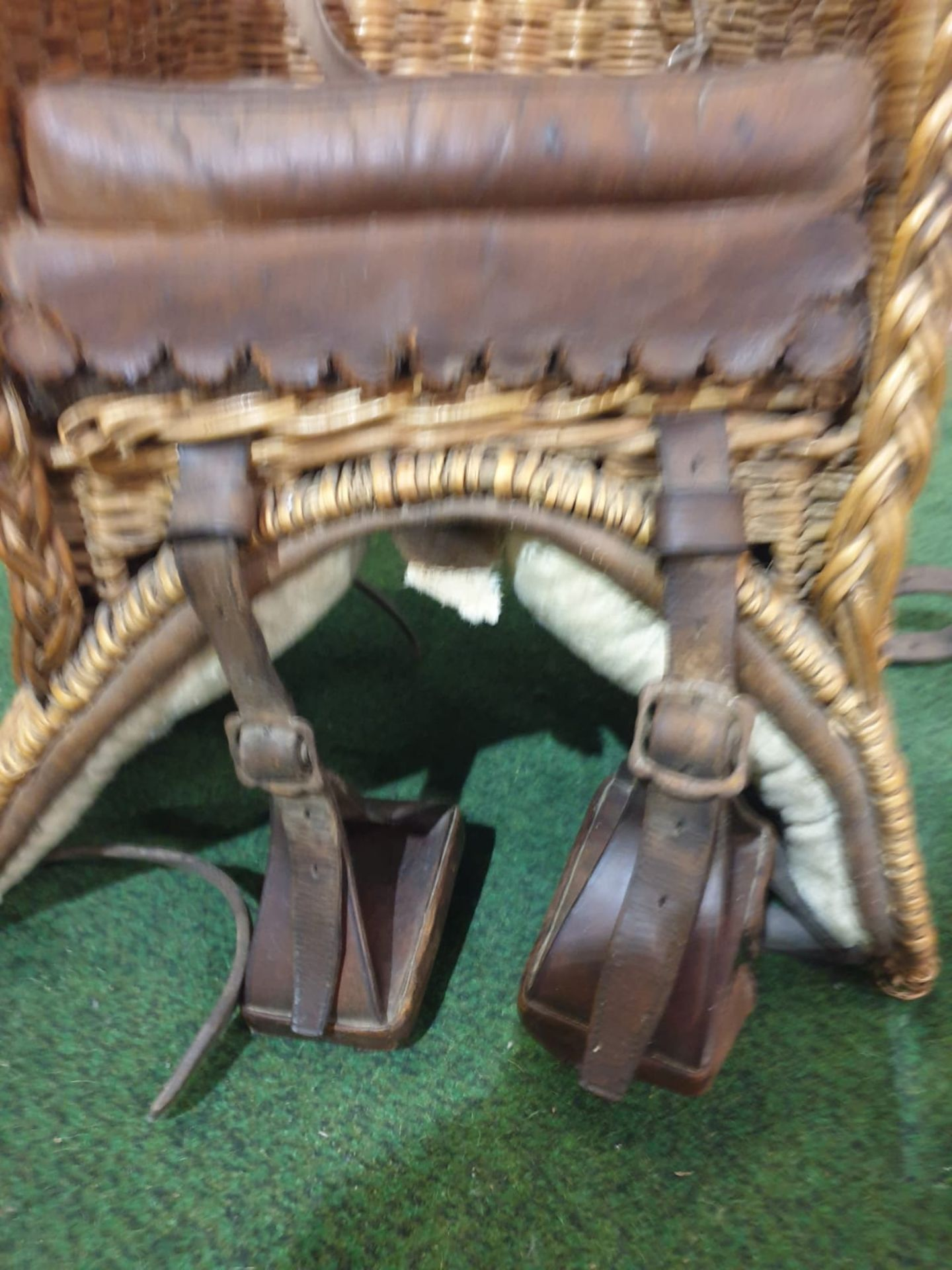 A wicker childs horse saddle formed as an armchair with straps and stirrups. c. Circa 1910 Height 60 - Image 4 of 7