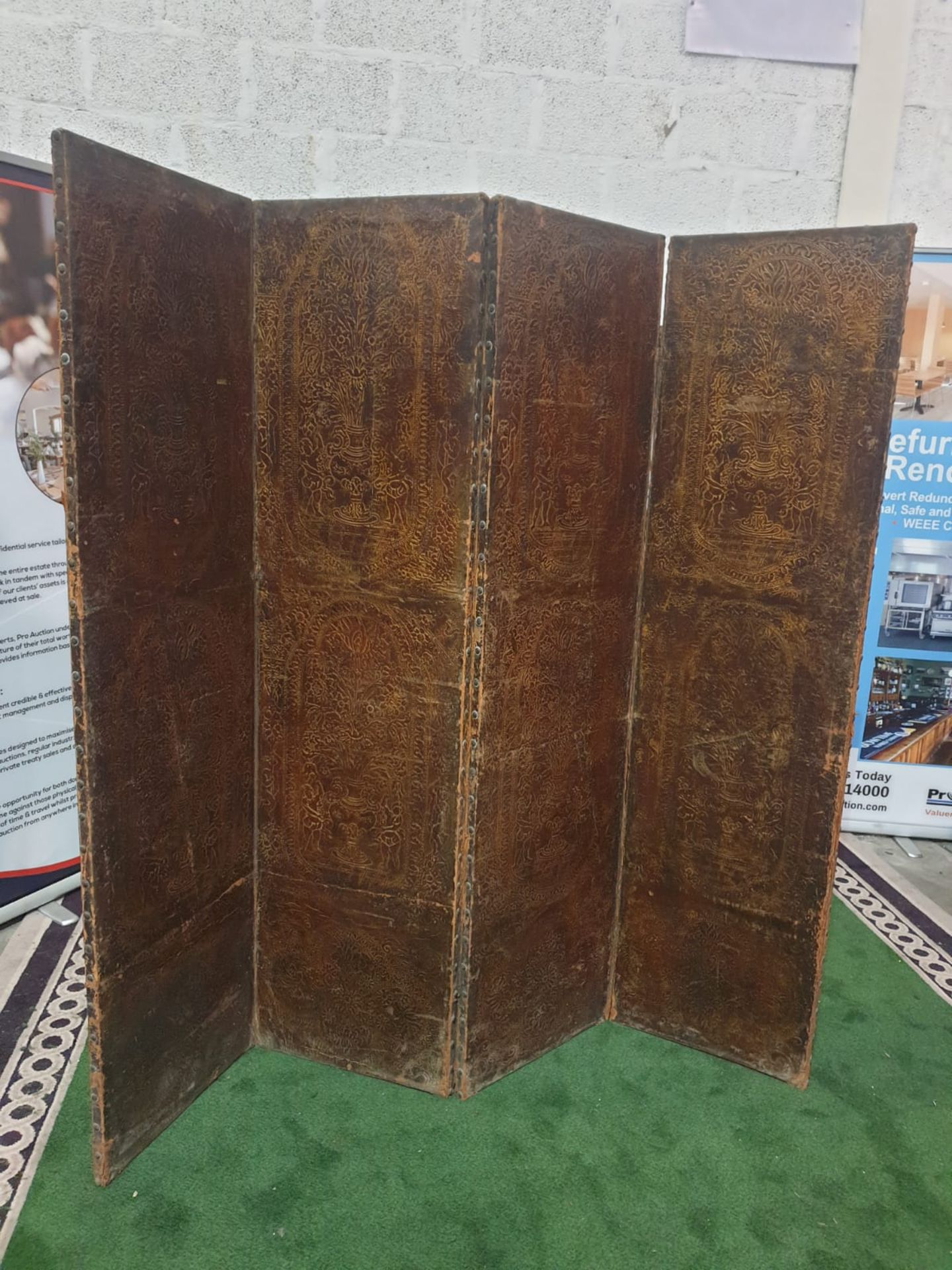 A 17th century style leather covered four fold screen, probably Spanish. Each fold covered in two - Image 2 of 3