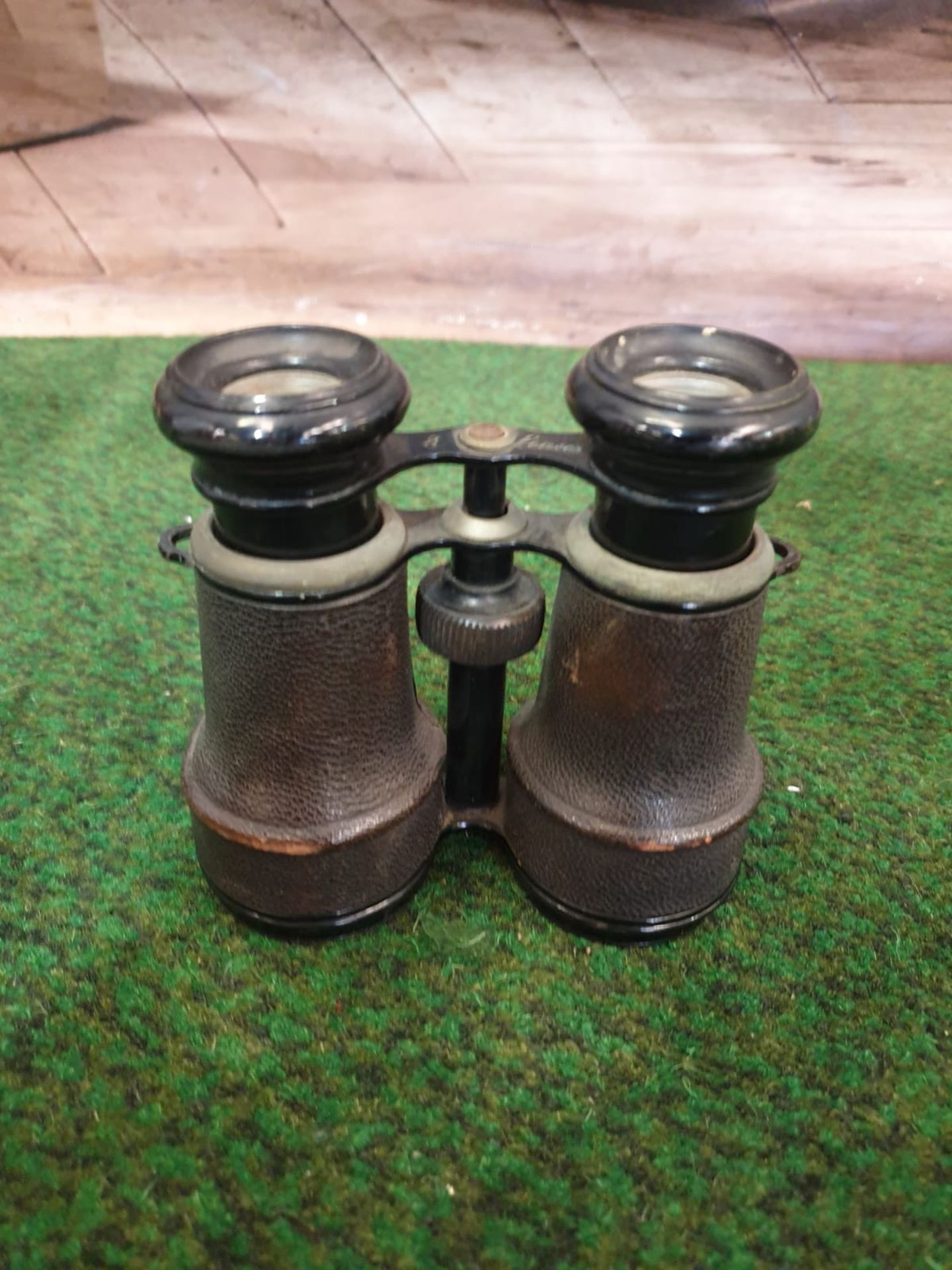 A Pair of vintage binoculars with black leather covered casing and black enamel trim, a compass is - Image 2 of 5