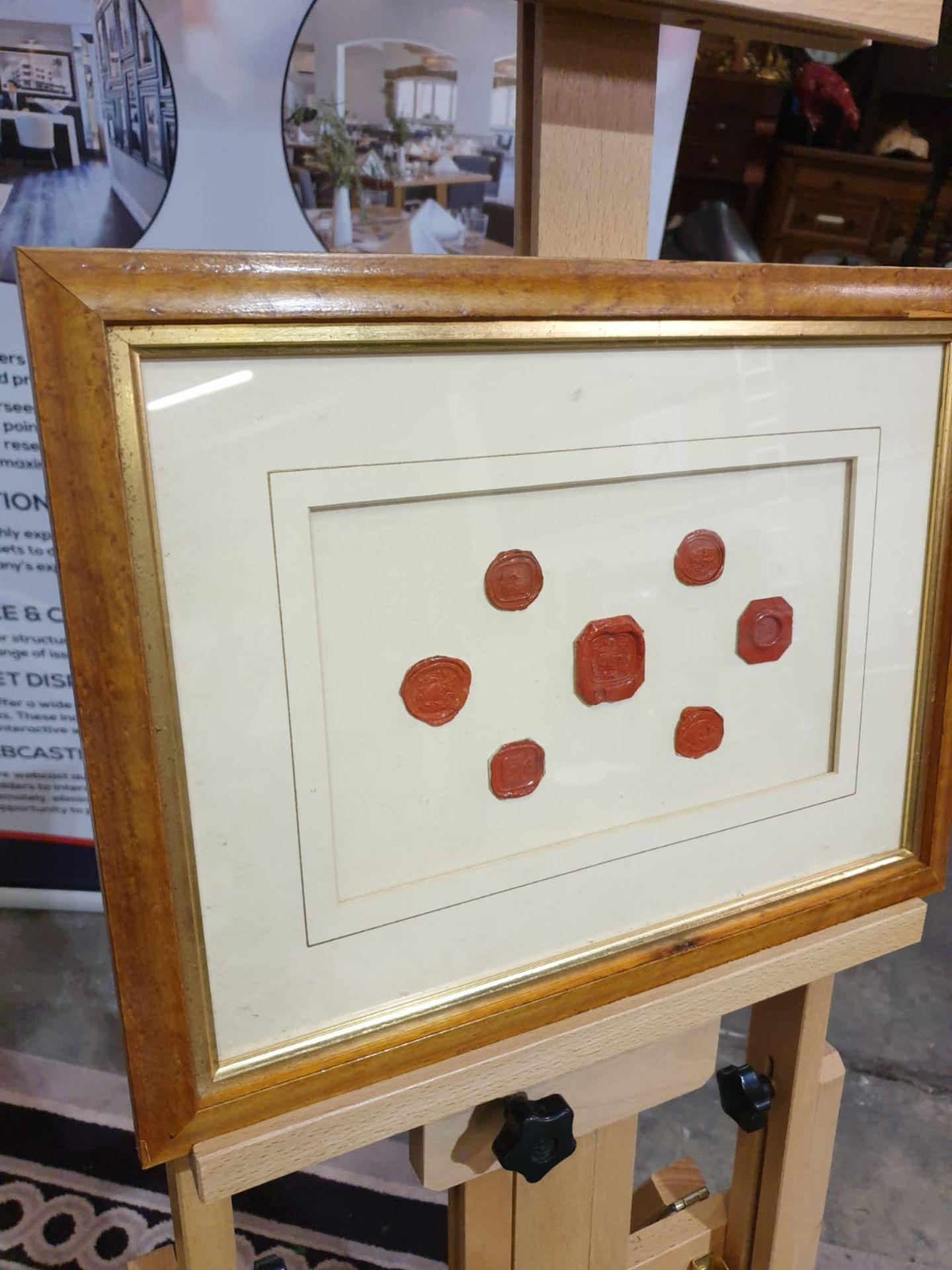 Framed artwork of wax Seals in Wood frame 42 x 32cm