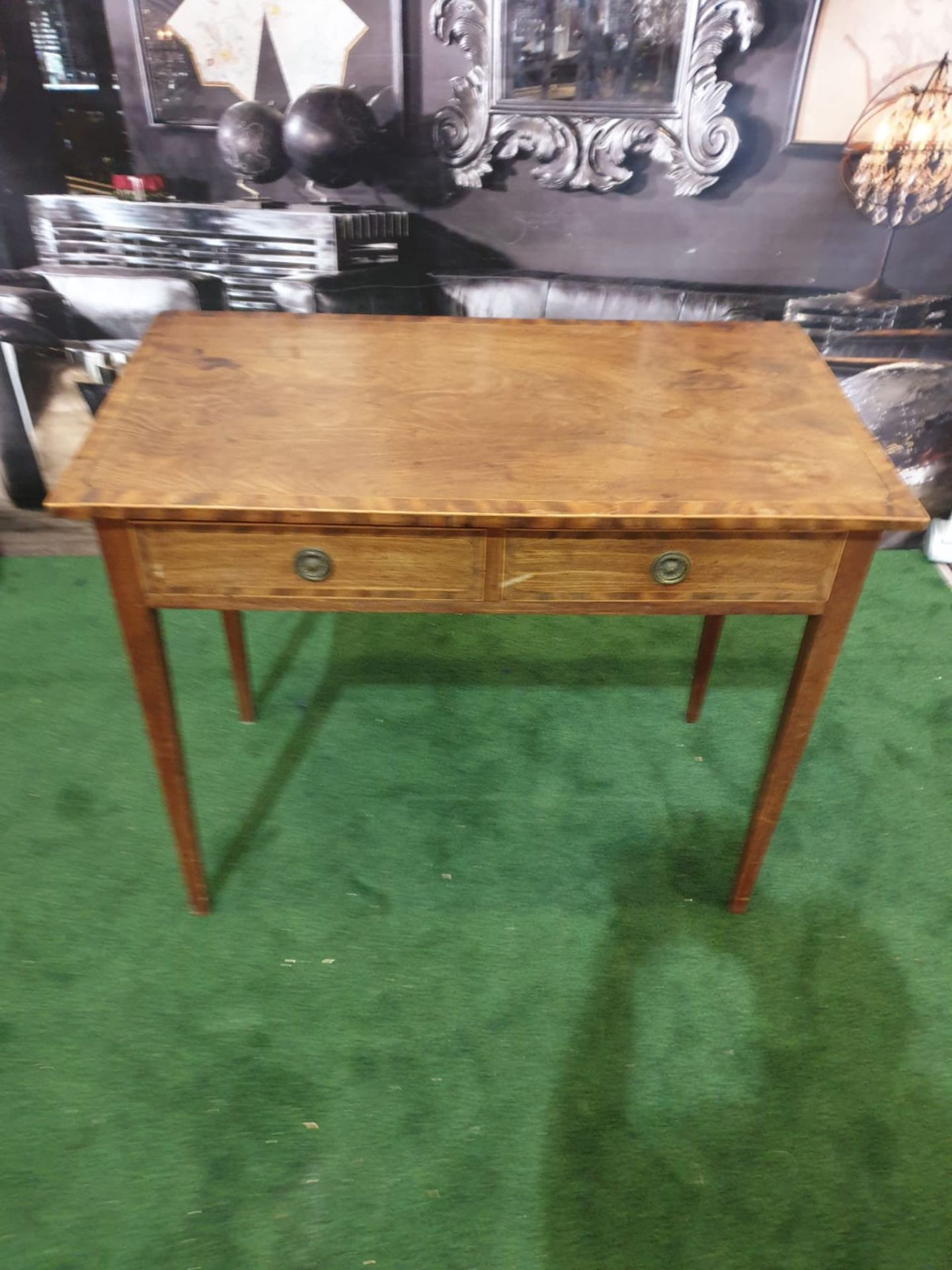 A George III mahogany side table. Strung with boxwood and crossbanded, the oblong top above a pair