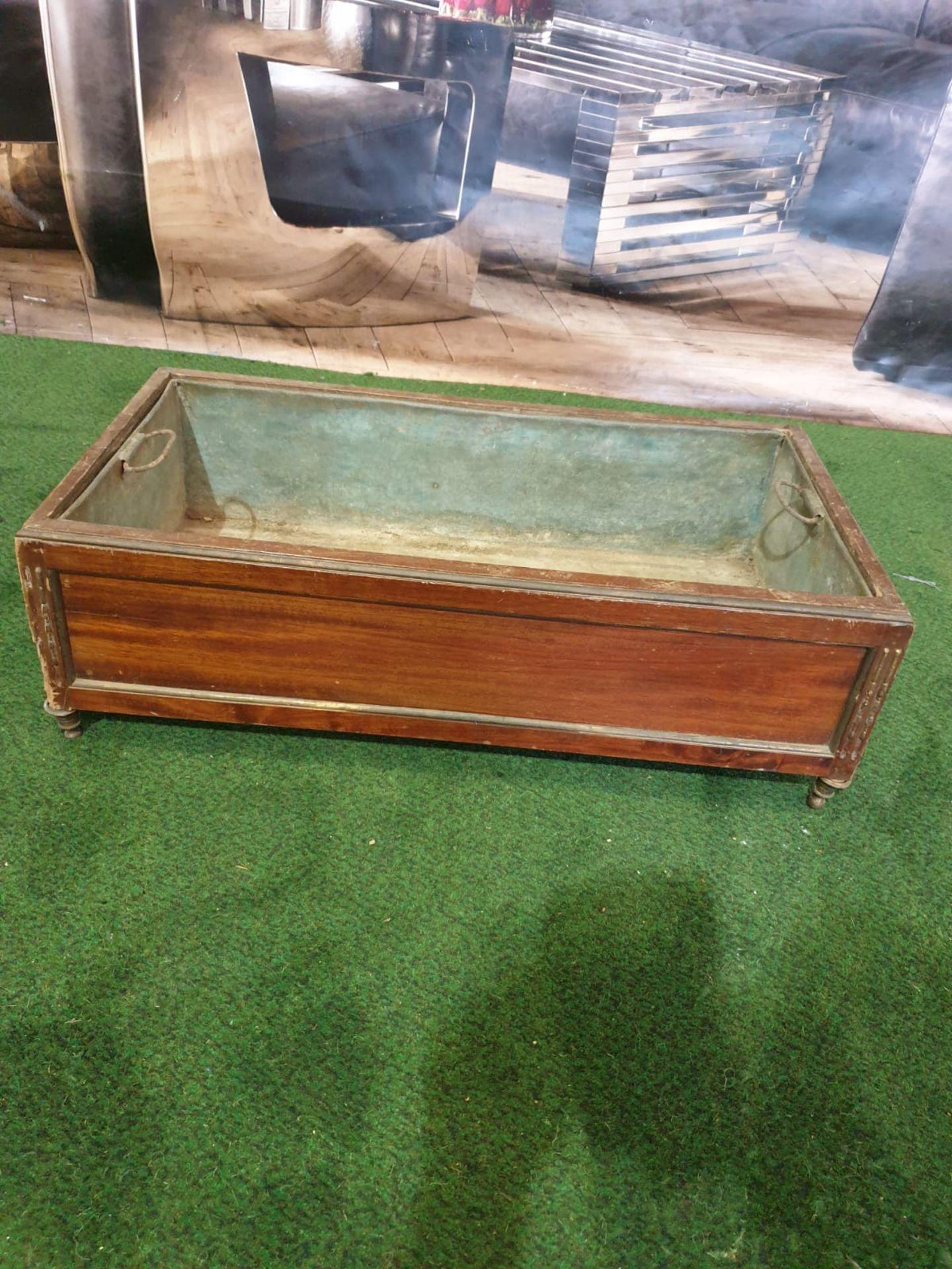 A Regency style Inlaid Mahogany Planter trough with original metal insert on shaped bun feet 65 x 35