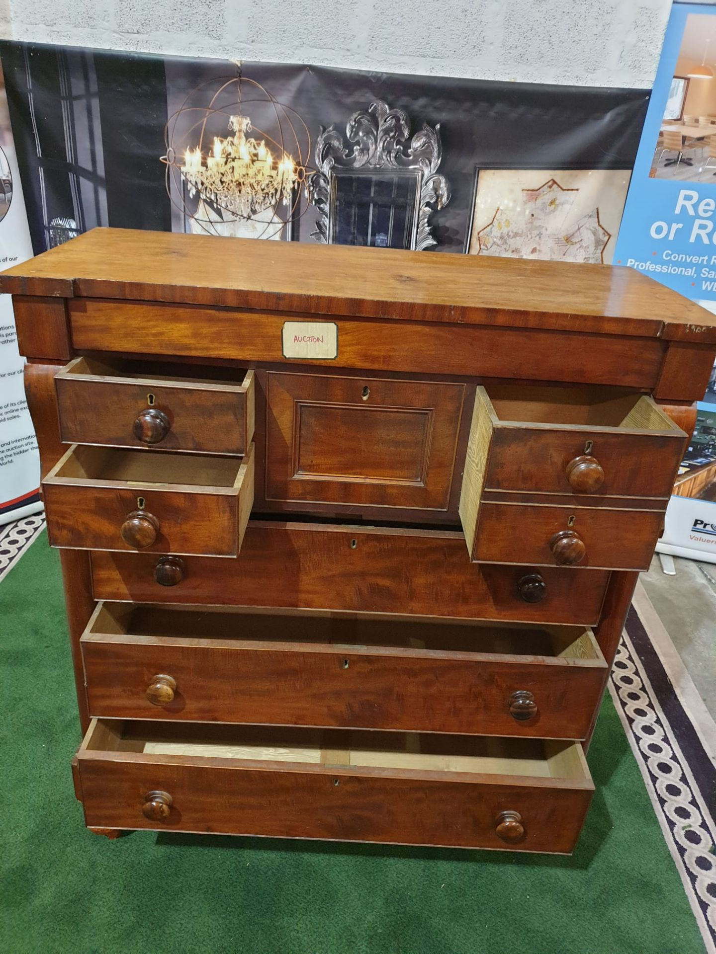 A Victorian mahogany chest. The oblong top above a flush frieze and a panelled hat drawer flanked by - Image 4 of 6