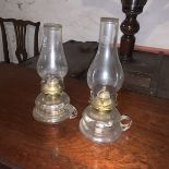 A pair of Griffin Brand glass oil lamps with carrying handles c. Circa 1920 Height 26 cm; Length