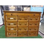 A Victorian oak office chest of drawers. With rounded corners and panelled sides, the top long