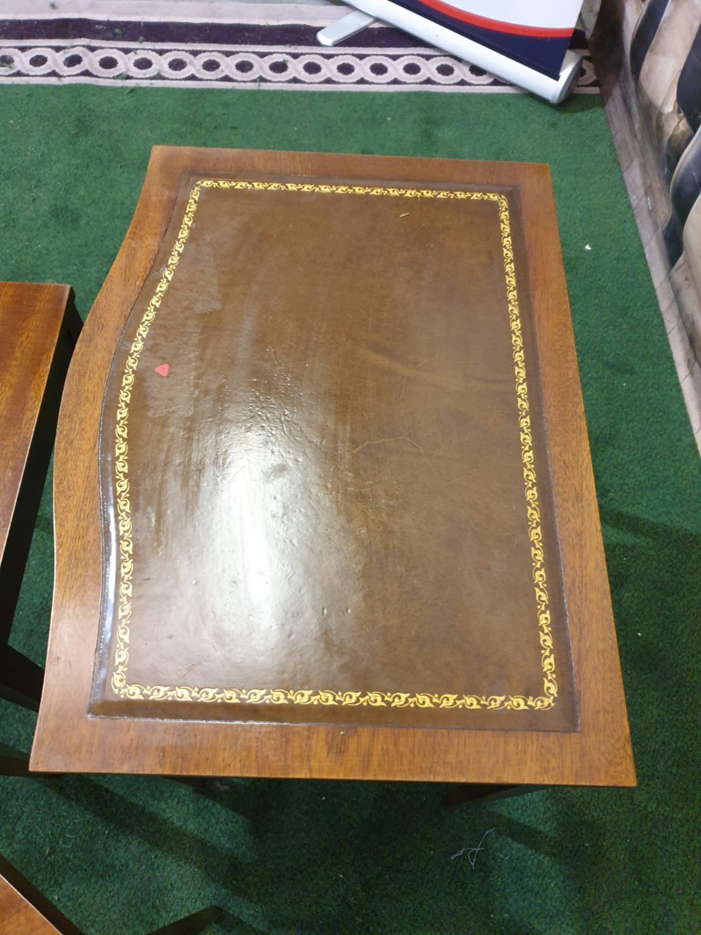 A nest of three mahogany bow front tables in the George III style. The largest table with a gilt - Image 5 of 5