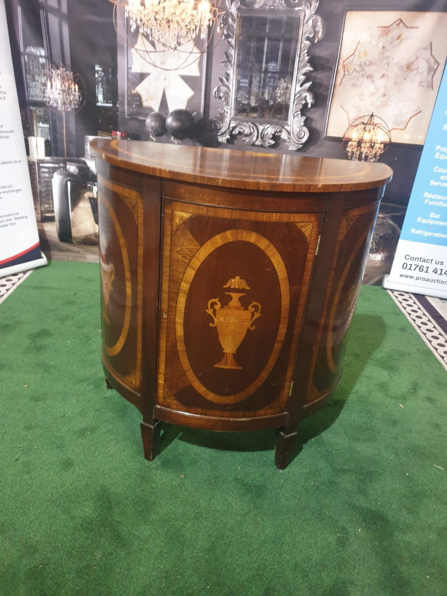 A Late Georgian style reproduction mahogany Demi Lune Cabinet With a single door with oval panels