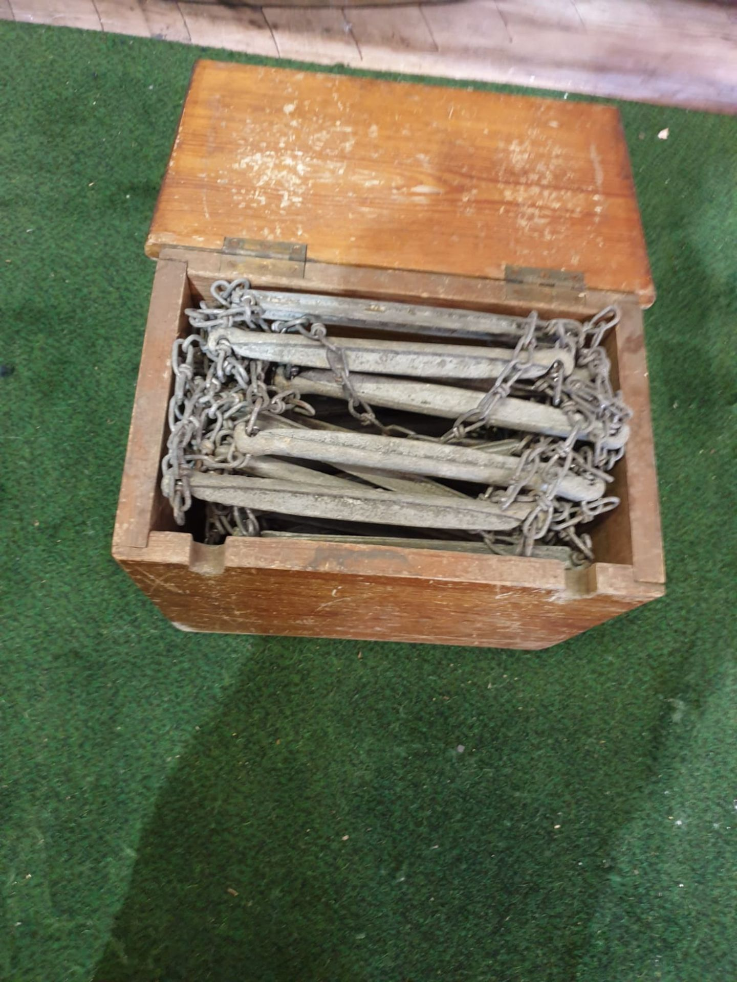 A vintage escape ladder in box 38 rungs of metal on linked chain approximately 10m in length in