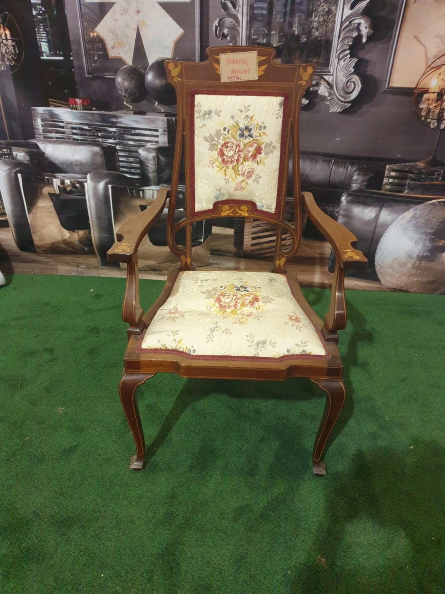 A mahogany and marquetry armchair.The flower and leaf-inlaid shaped toprail above an oblong padded - Image 2 of 5