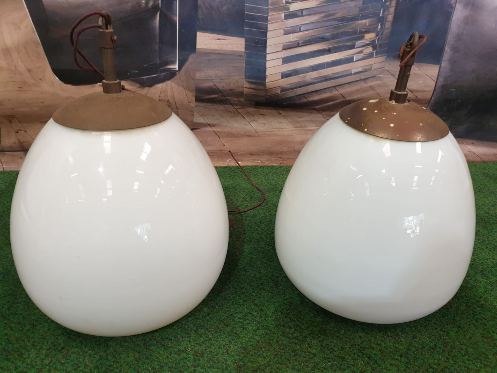 A pair of white glass and metal mounted pendant lights.Of ovoid form and with copper caps and - Image 3 of 3