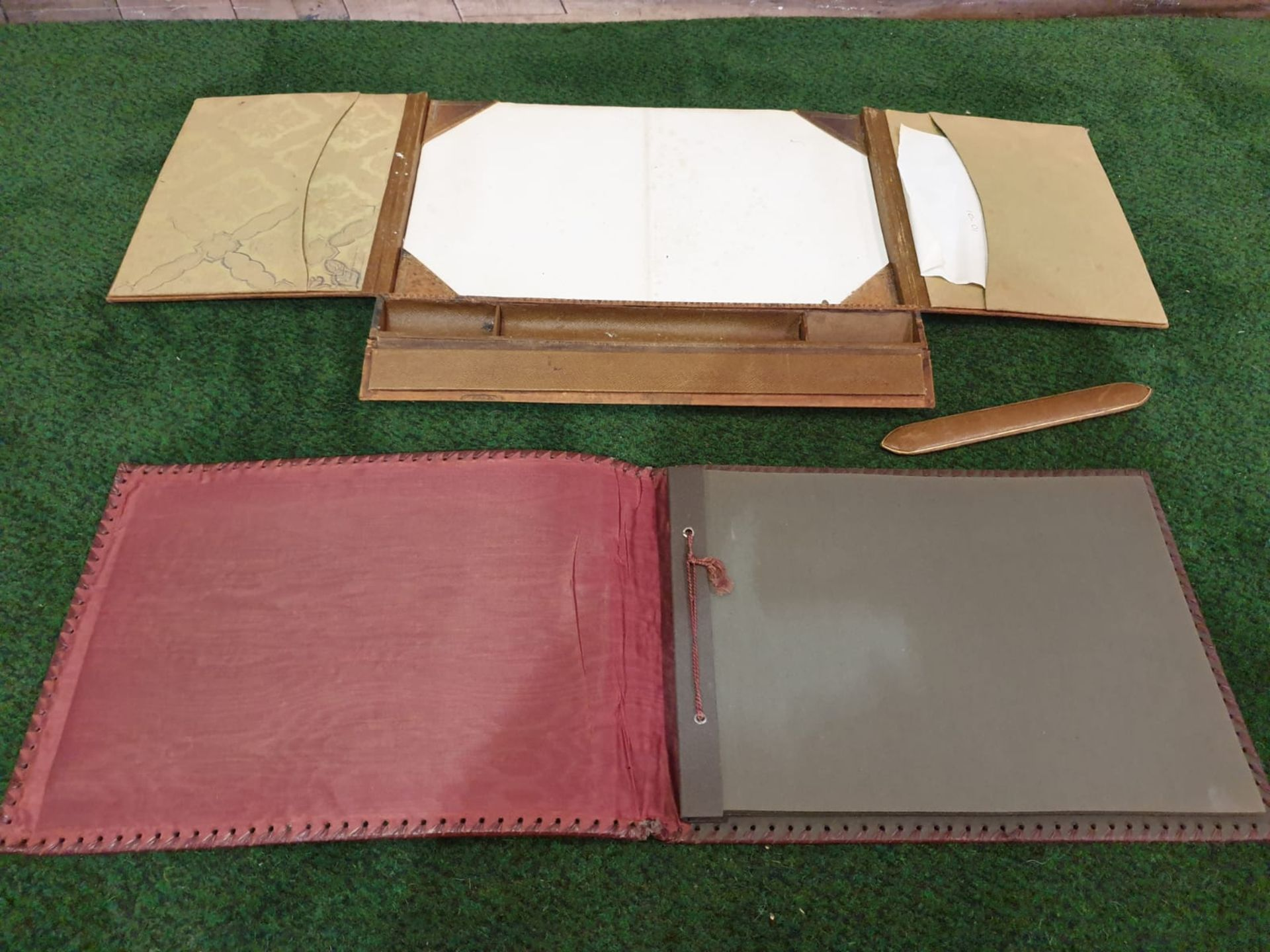 A vintage red leather with picture inset photo album and a tan light brown leather writing pad - Image 3 of 3