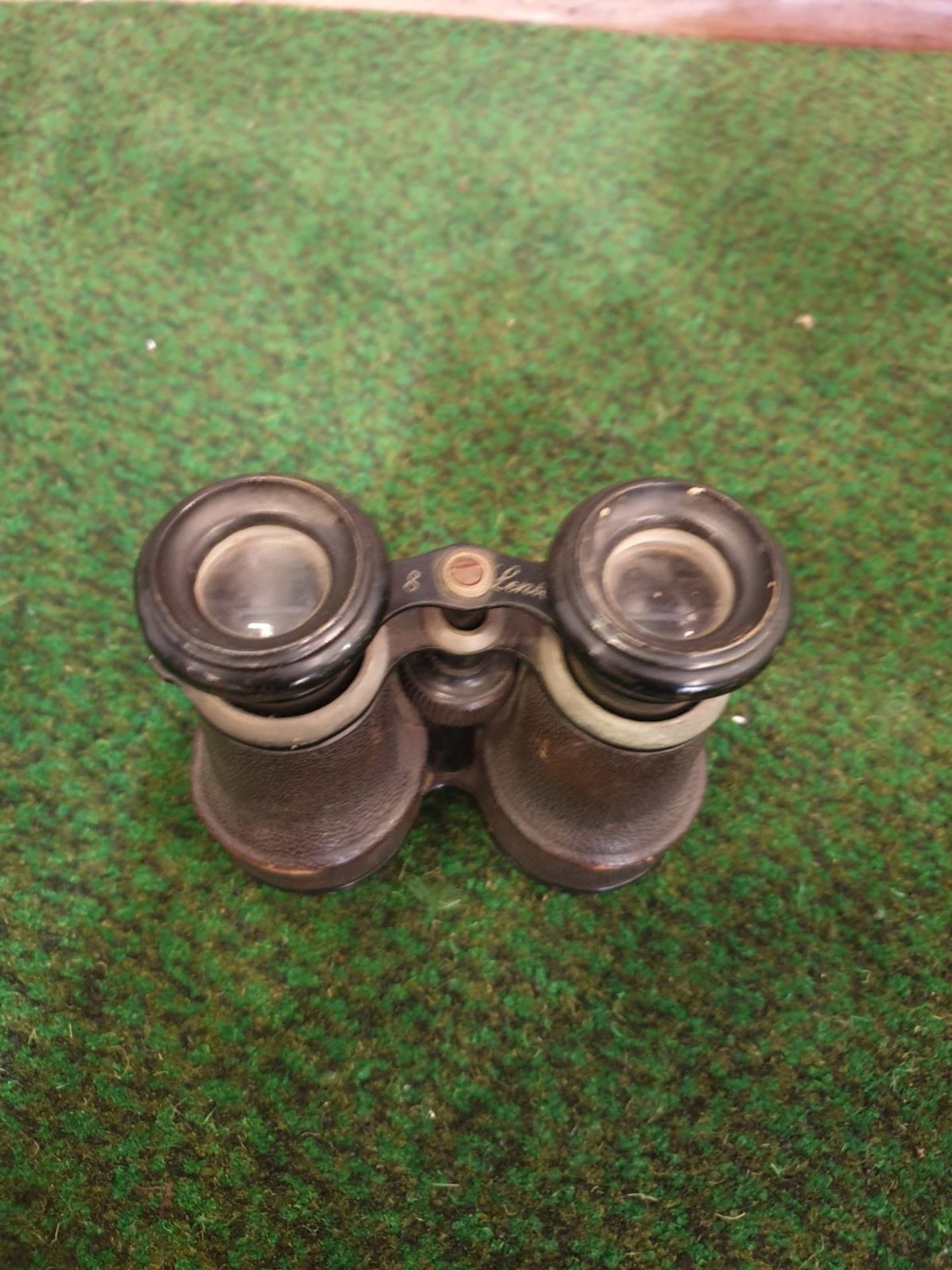 A Pair of vintage binoculars with black leather covered casing and black enamel trim, a compass is - Image 3 of 5