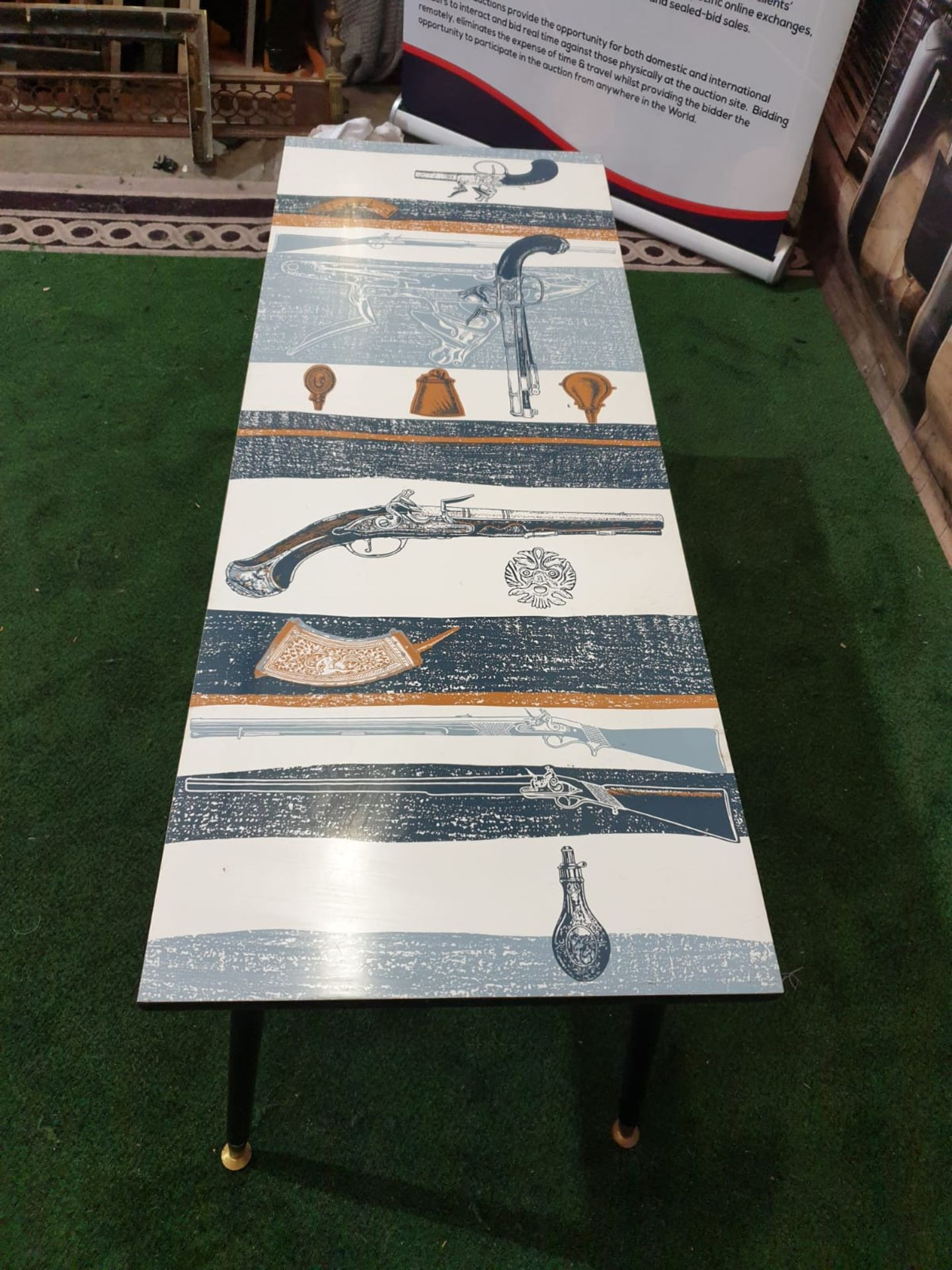 A 70's retro Coffee table with Pistol motifs laminated top on black legs 122 x 46 x 49cm - Image 3 of 3