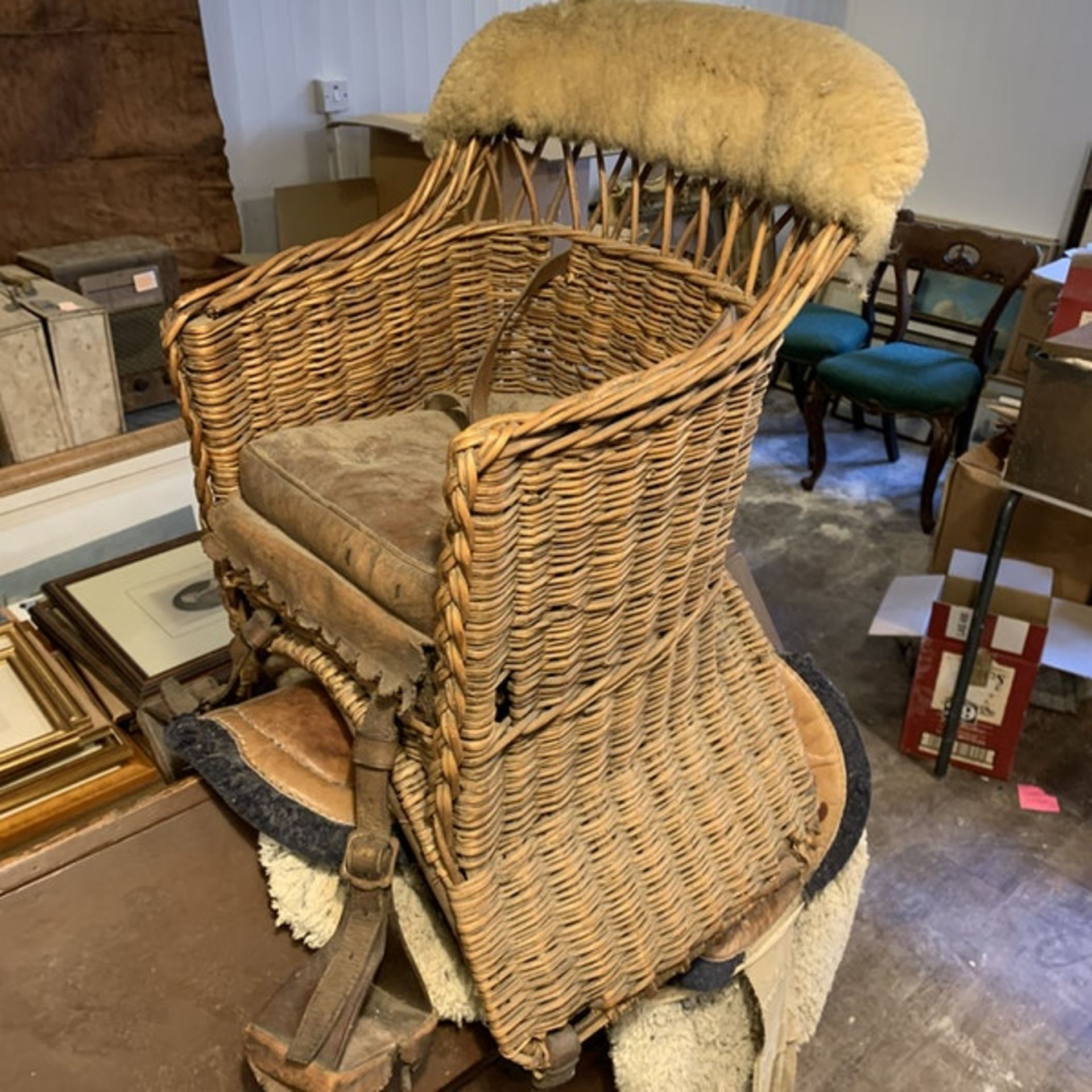 A wicker childs horse saddle formed as an armchair with straps and stirrups. c. Circa 1910 Height 60