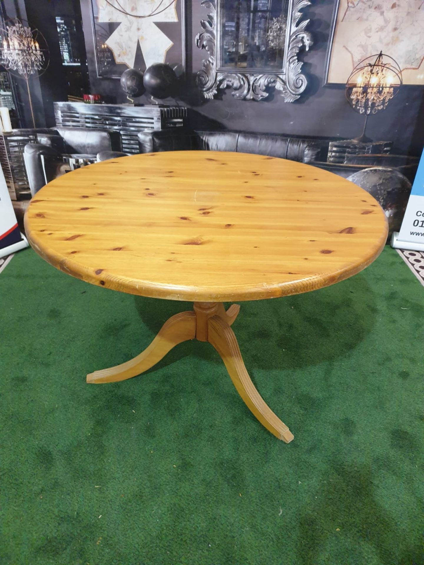 Round Dining Table in Repurposed Pine with Antique Pine Pedestal The table's pedestal, which is
