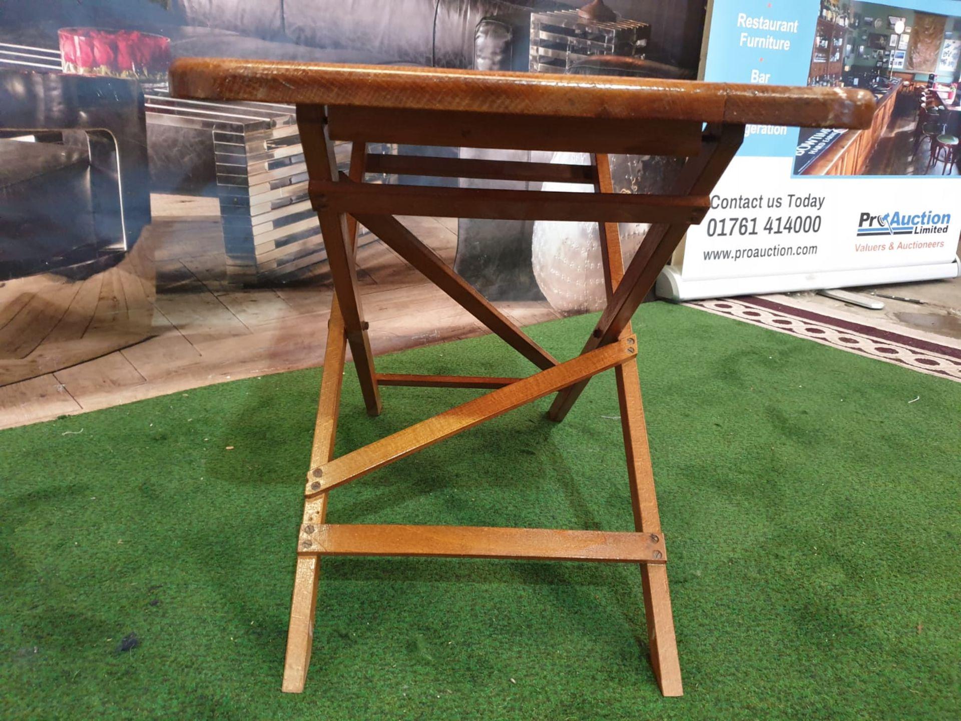 A polished teak folding table 71 x 40 x 4cm - Image 4 of 5