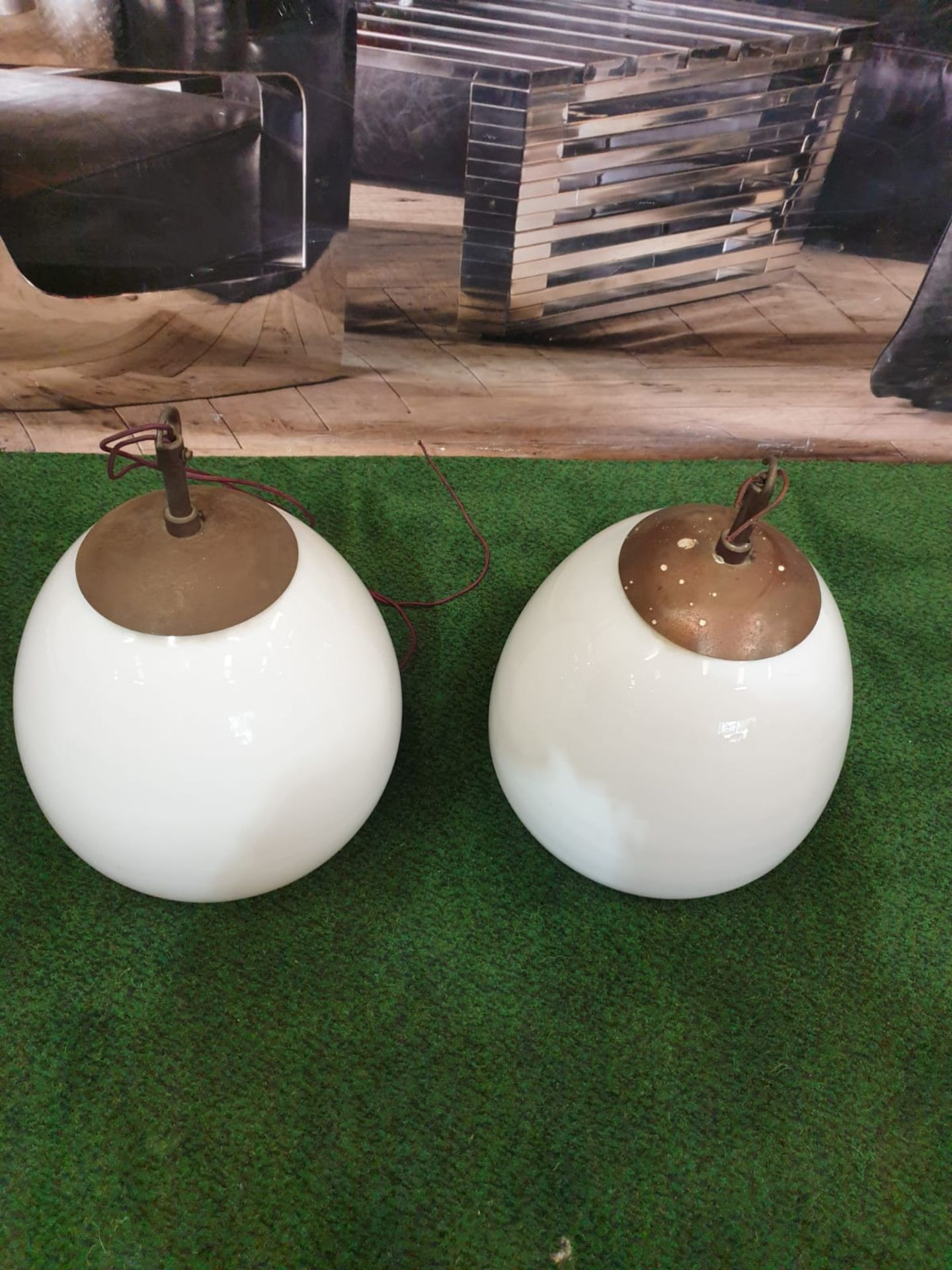 A pair of white glass and metal mounted pendant lights.Of ovoid form and with copper caps and - Image 2 of 3