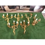 A set of 4 x French Dore Bronze triple arm branch Candelabra wall sconces in the Louis XV Style