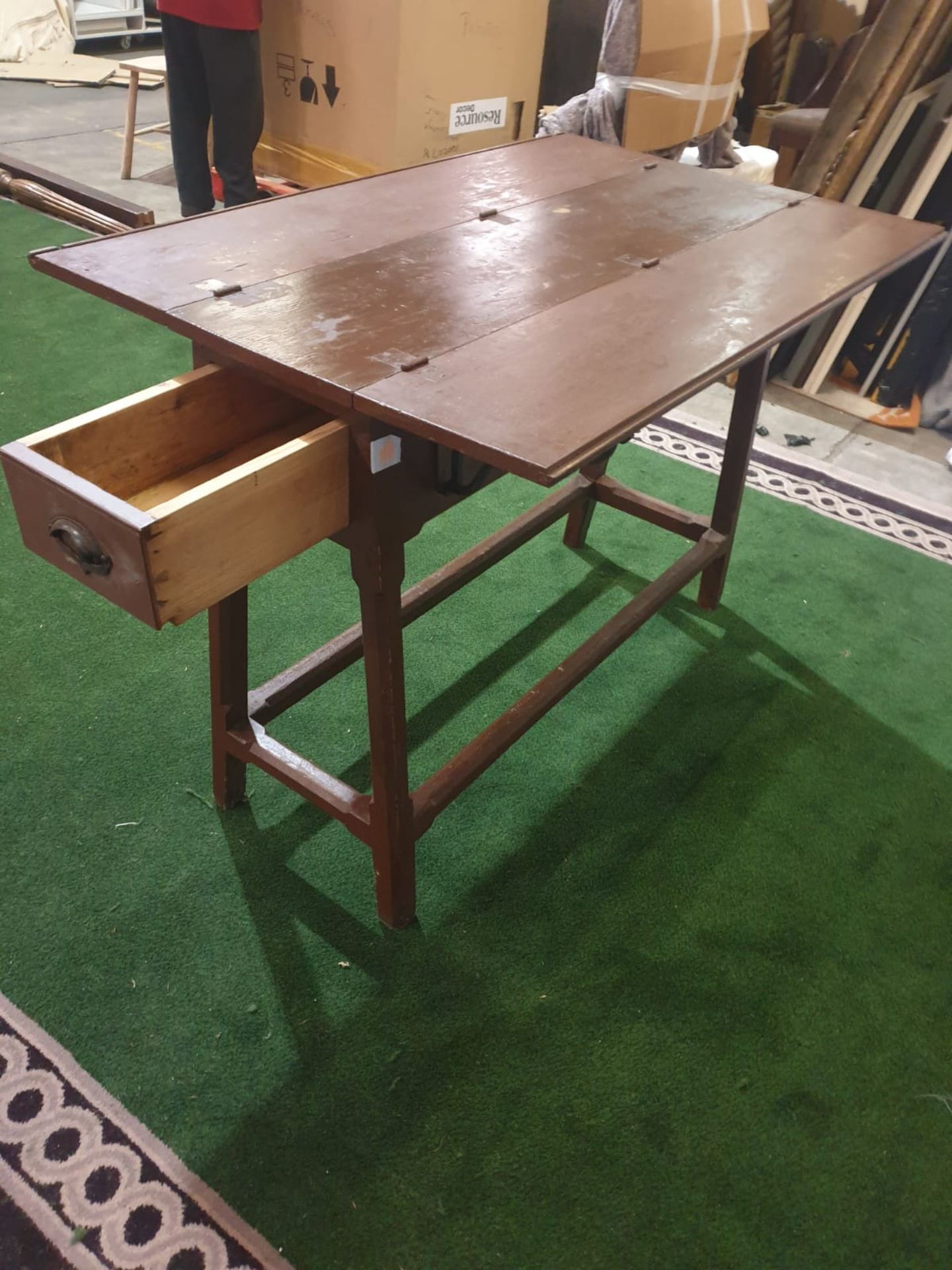 Stained wooden folding two-leaf table on tapering legs joined by a plain rail and having a drawer - Image 2 of 2