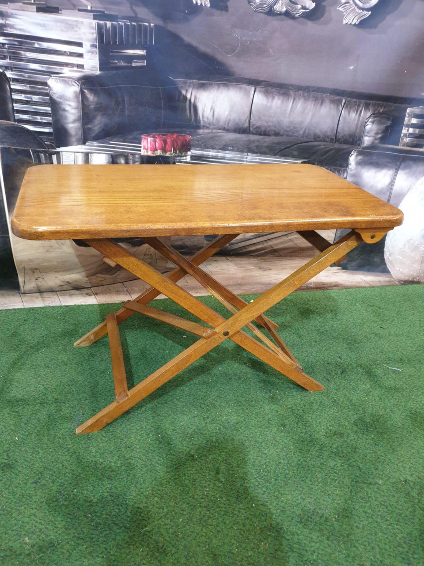 A polished teak folding table 71 x 40 x 4cm