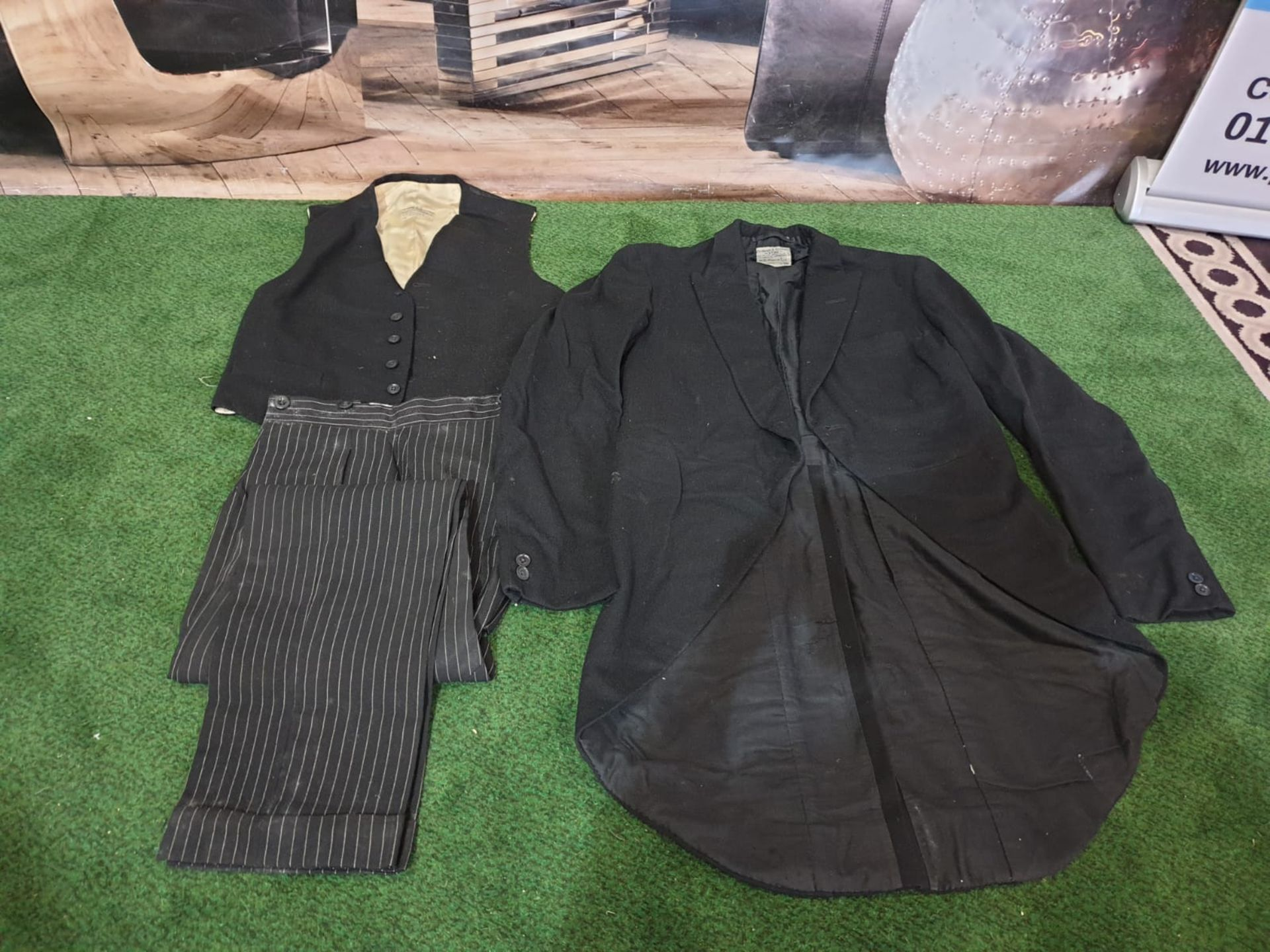 A Denman and Goddard Ltd 3 piece Eton suit consists of morning tailcoat, 2 x waistcoats and 2 x