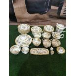 A Paragon England fine bone China partial tea service floral with gold rim comprising of 11x serving