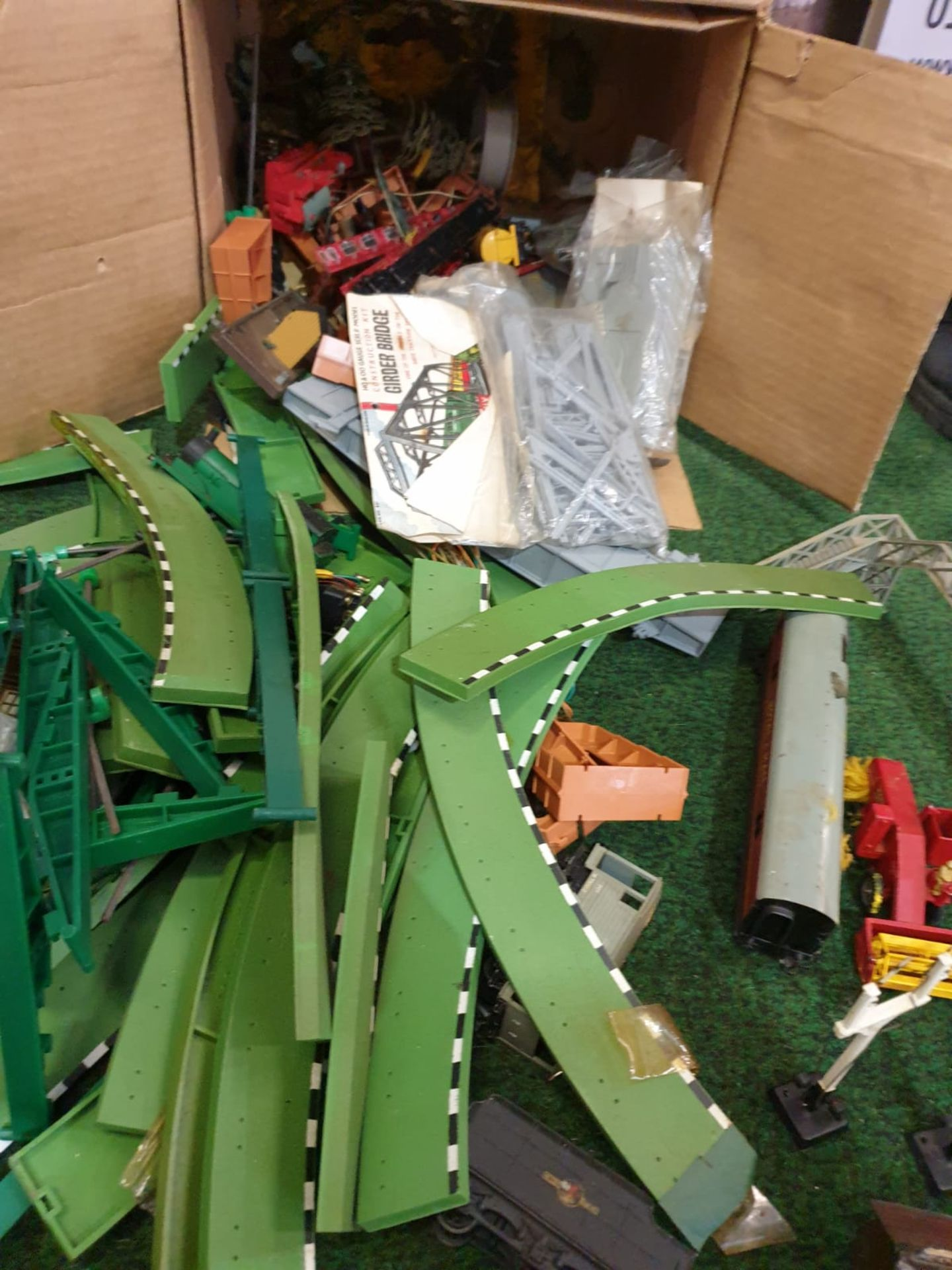 A box containing vintage Scalextric MM/T45G Green Straight Borders and train set accessories as - Image 2 of 2