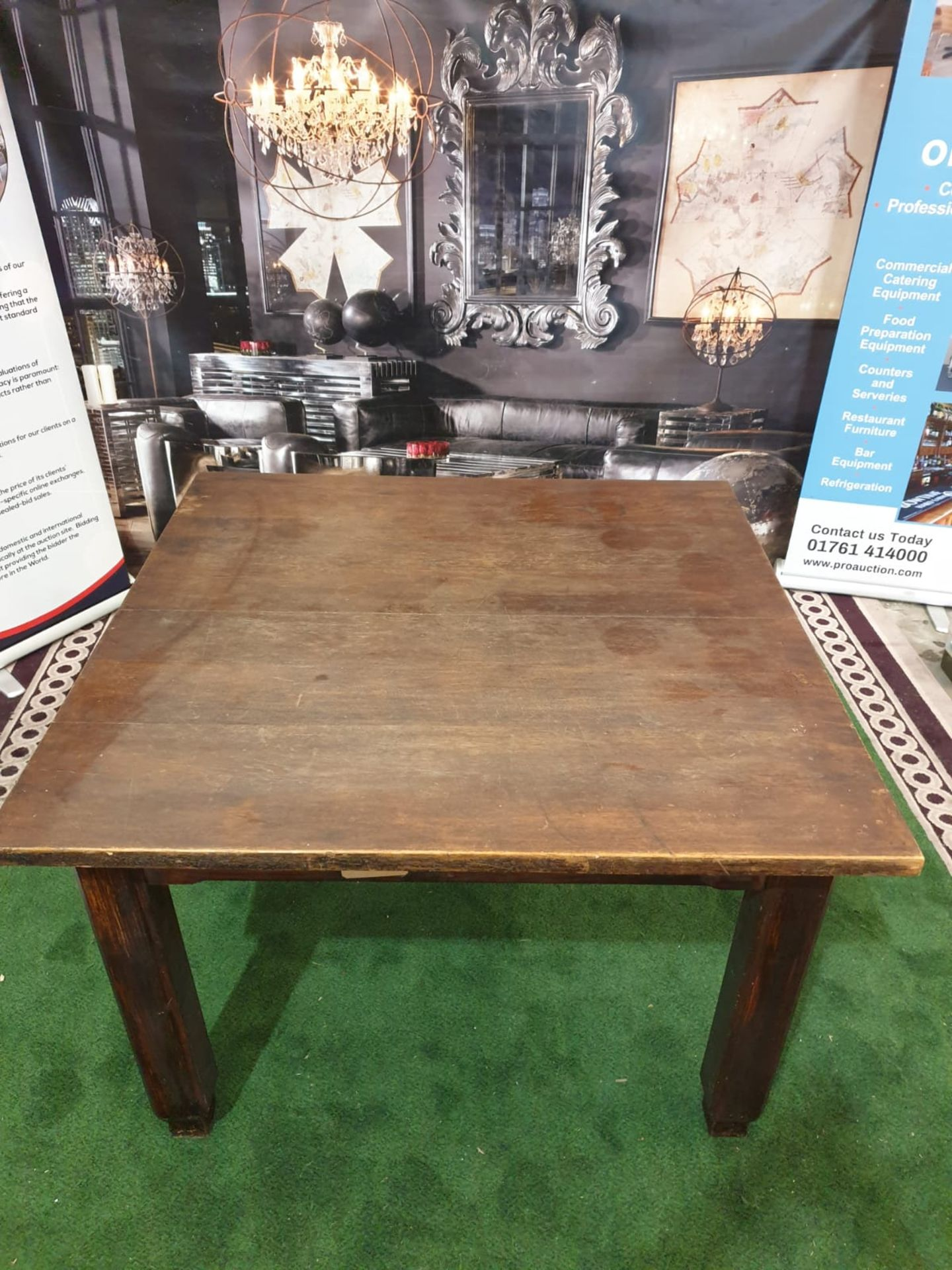 An English stained oak dining table. The square top on square chamfered legs with tapered feet. c. - Image 2 of 4