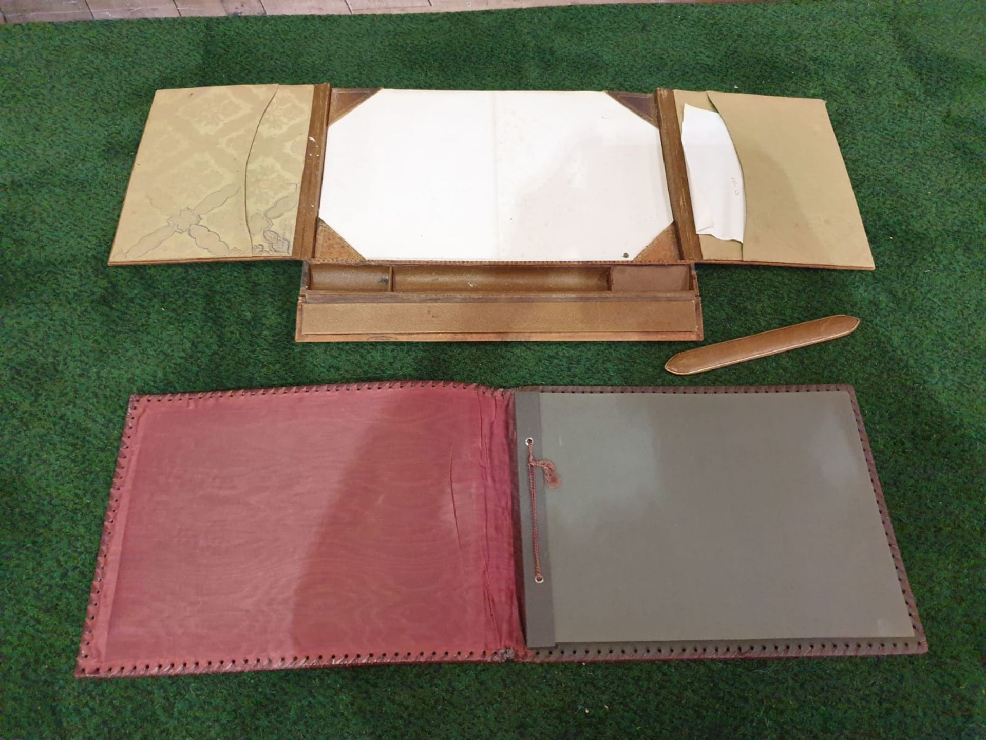 A vintage red leather with picture inset photo album and a tan light brown leather writing pad - Image 2 of 3