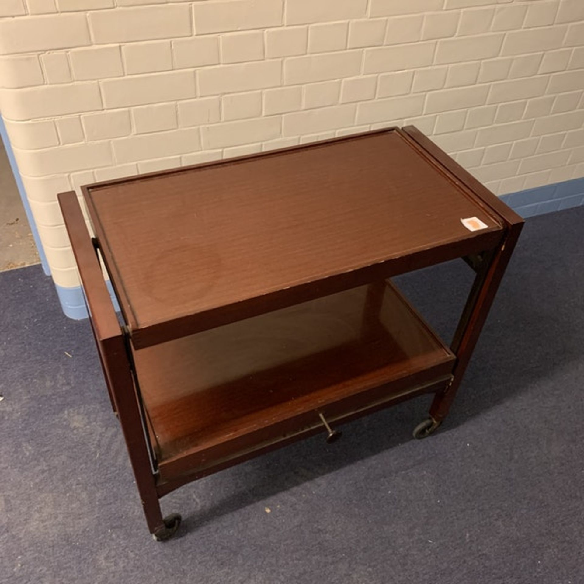 A teak adjustable serving trolley / gueridon The lower tier rising to form a double section upper