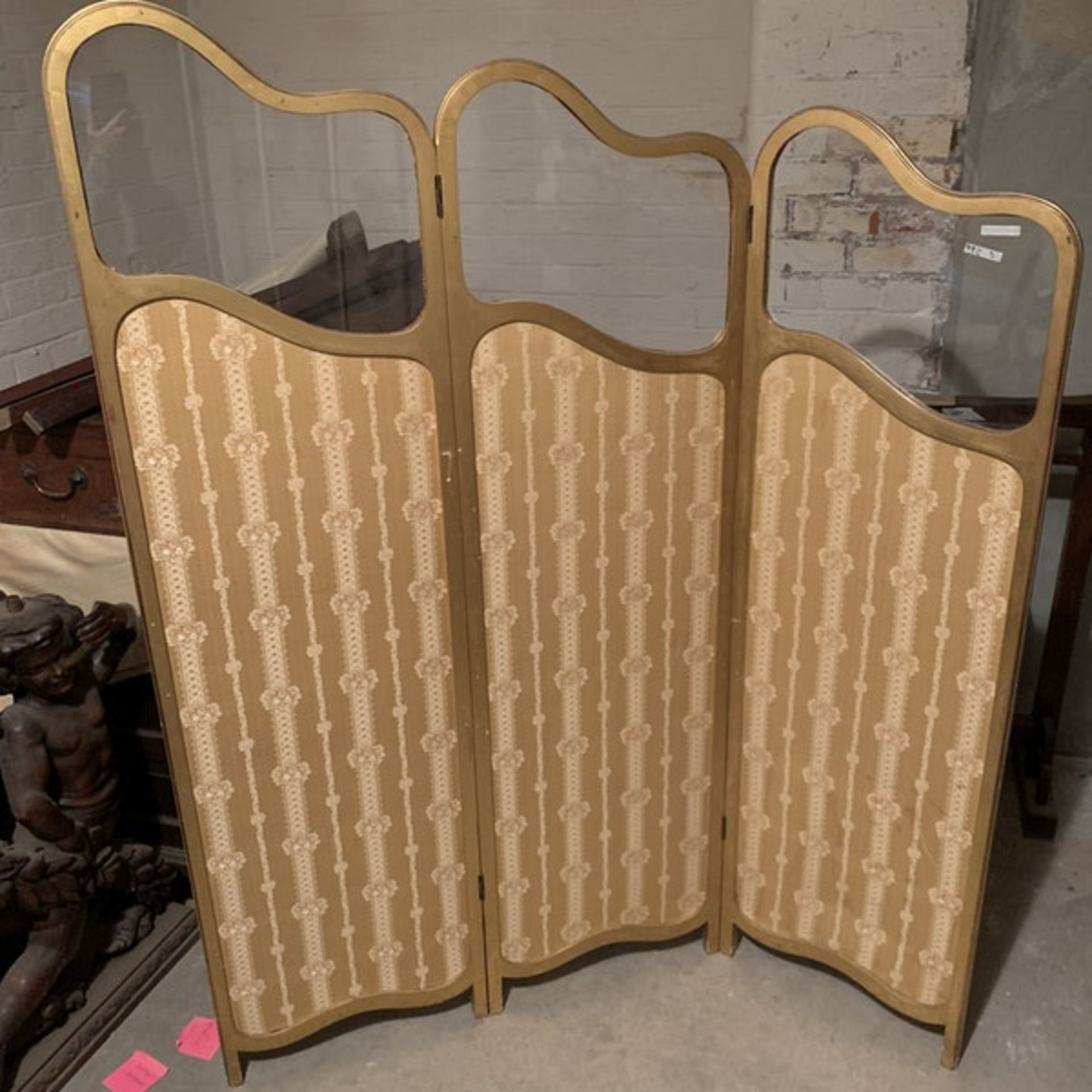 A giltwood and upholstered screen.The three graduated panels with glazed upper panels over damask- - Image 3 of 3