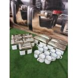 A quantity of enamel tins and cups as found with chrome clip lids 5 x large tins 25 x 13 x 10cm 6x