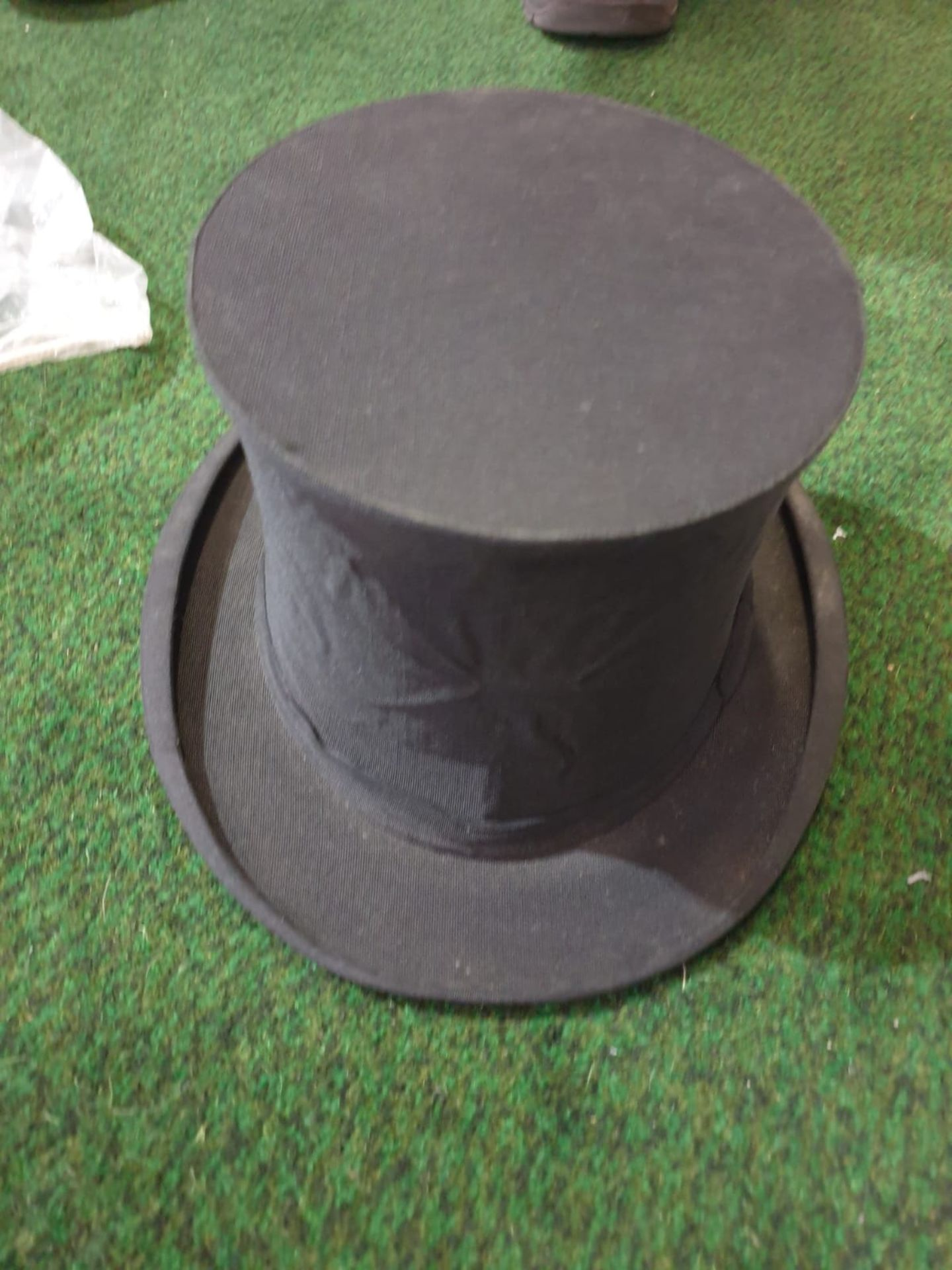 A Lock & Co London Naval peak cap and a Hunters Top hat by Harman & Son Hatters, 87 New Bond