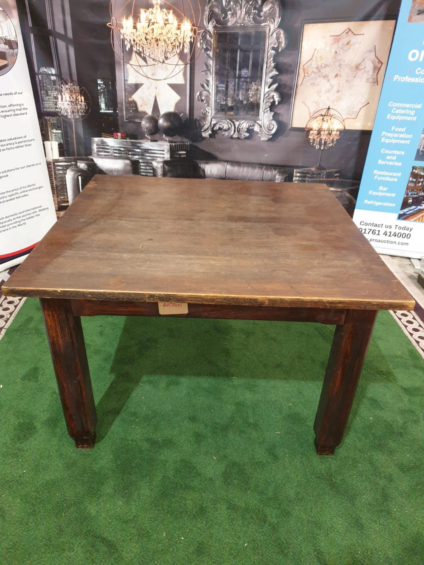 An English stained oak dining table. The square top on square chamfered legs with tapered feet. c.