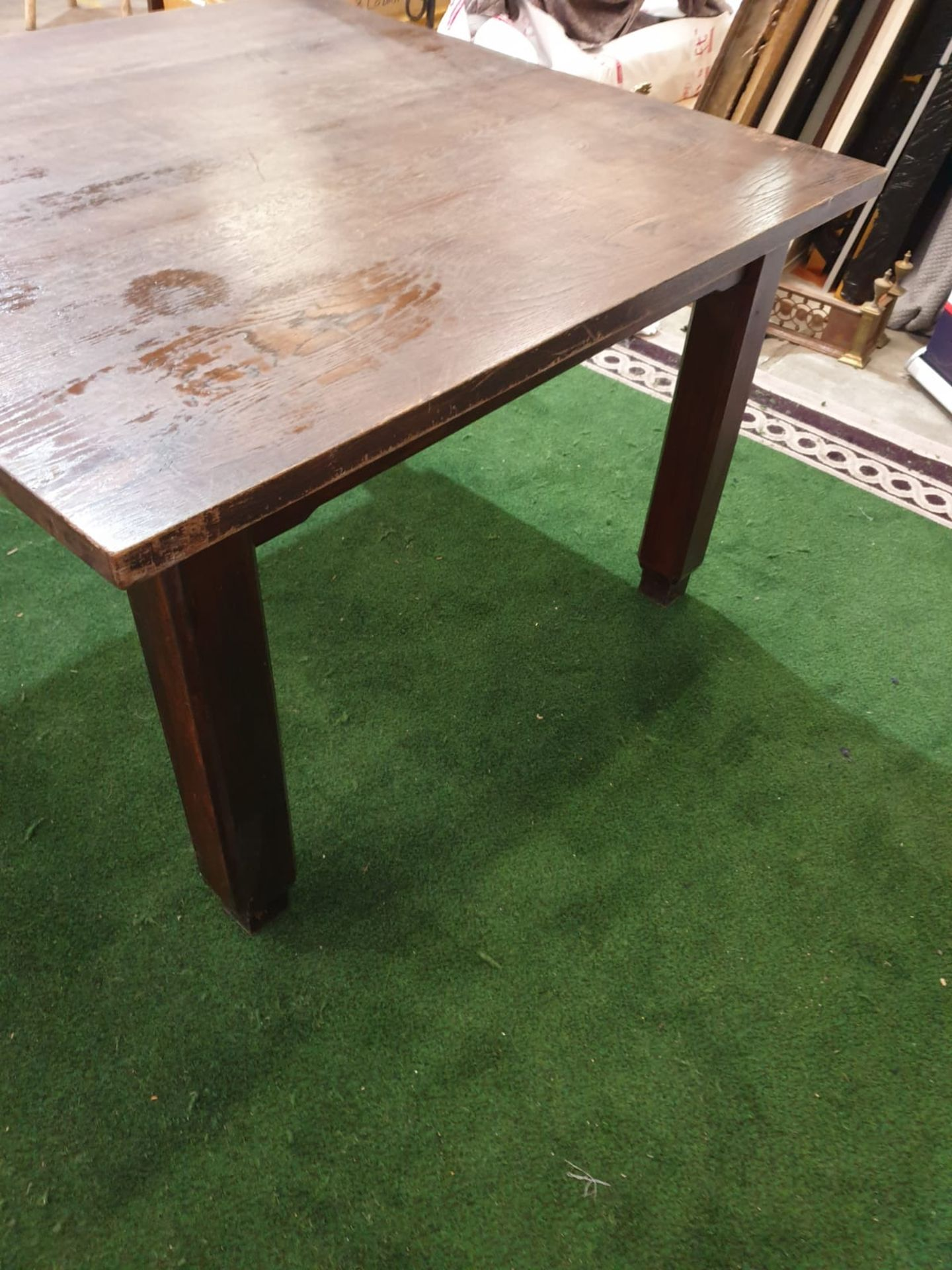 An English stained oak dining table. The square top on square chamfered legs with tapered feet. c. - Image 4 of 4