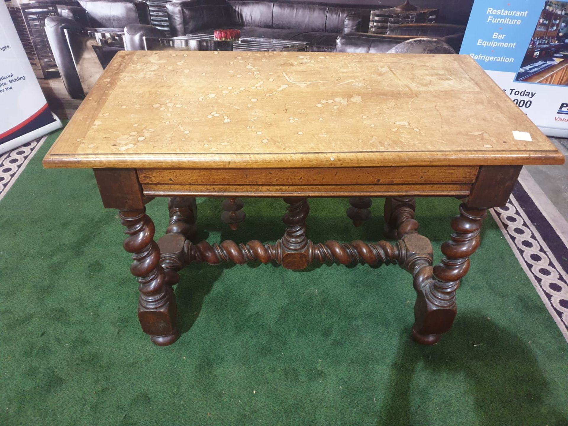 A Spanish 17th century style walnut side table. The faded cleated twin plank top above a drawer,