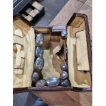 Travelling case Leather travelling vanity case fitted with silver lidded glass bottles and jars