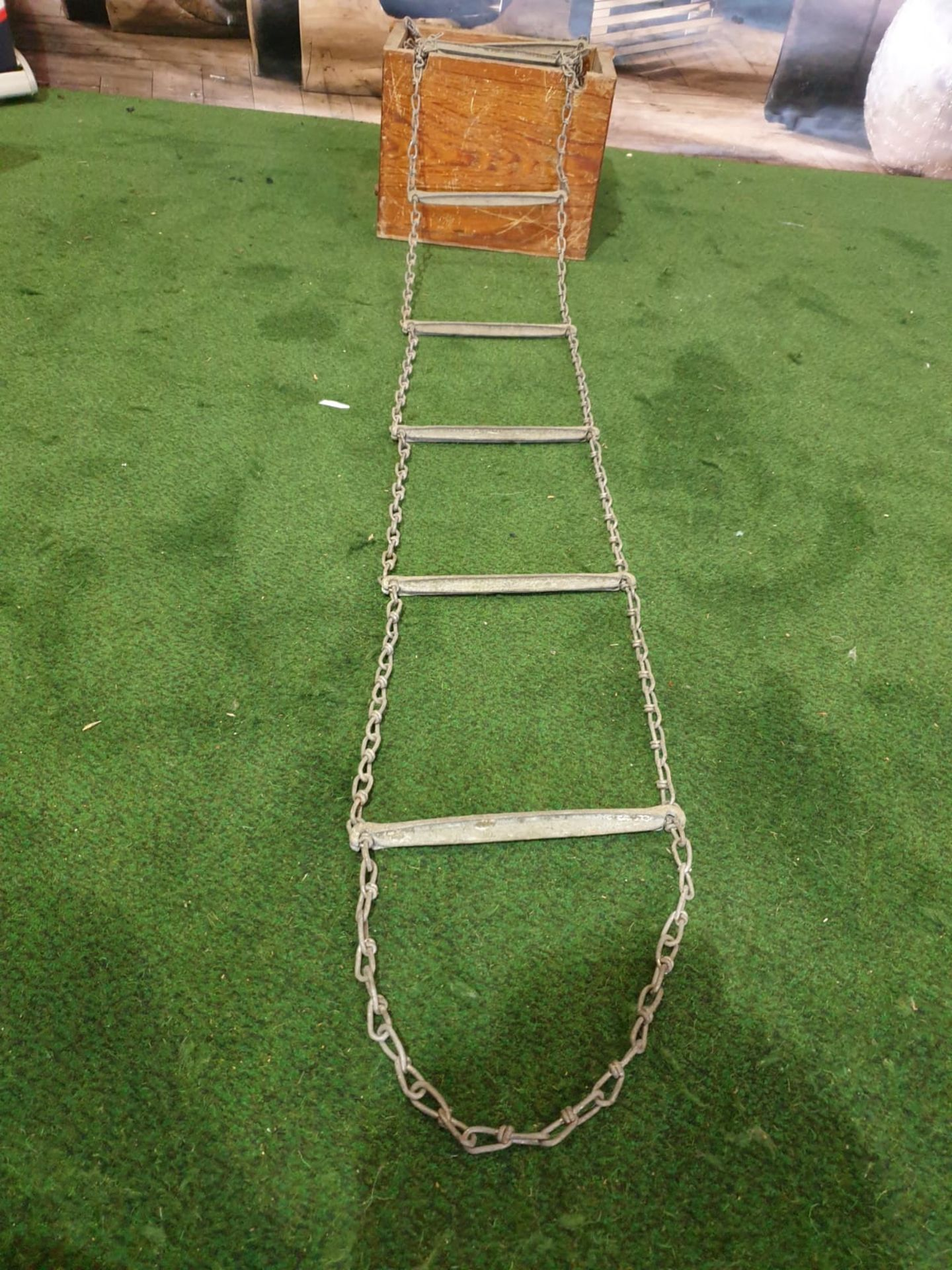 A vintage escape ladder in box 38 rungs of metal on linked chain approximately 10m in length in - Image 3 of 3