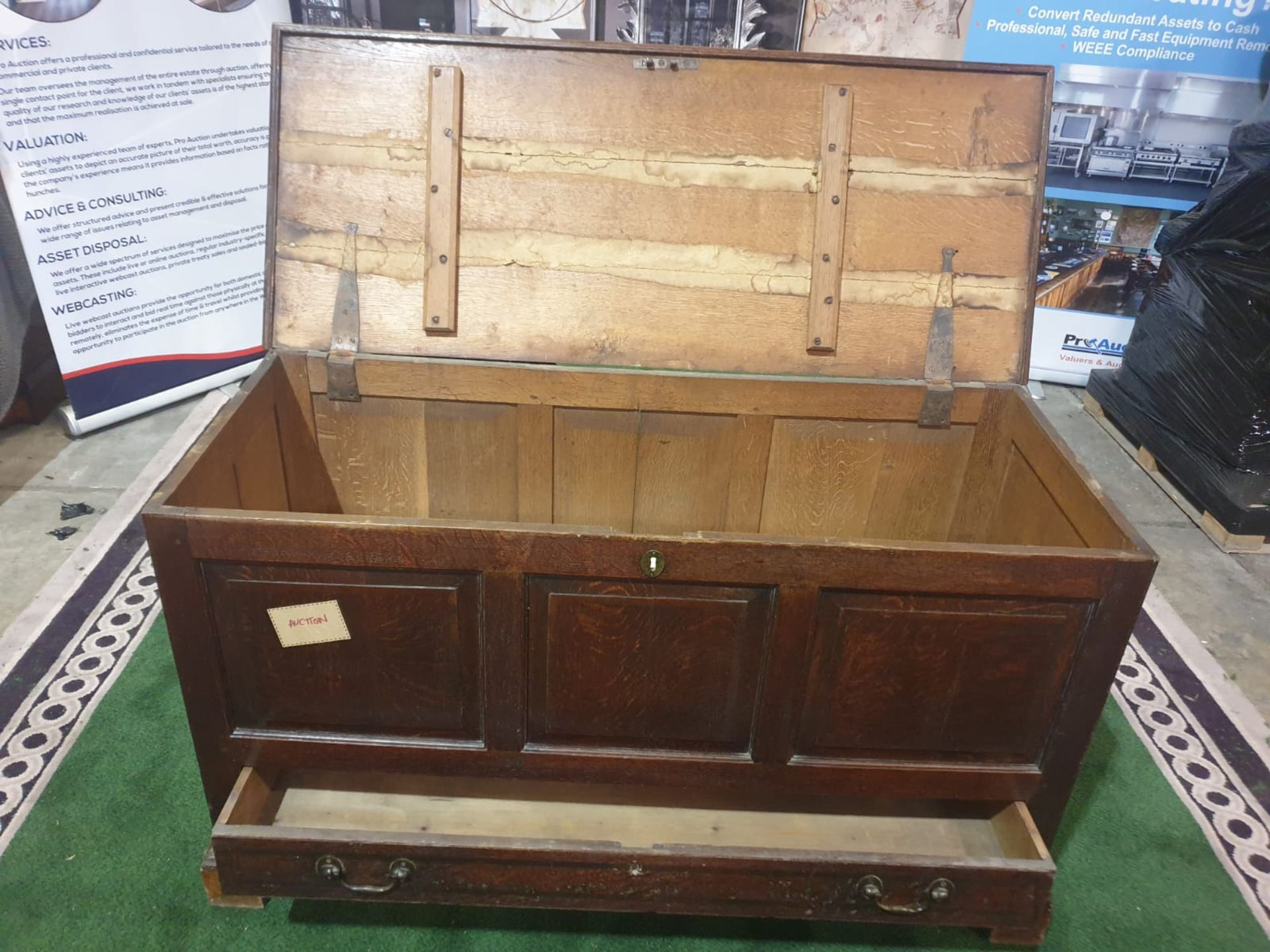 A George III oak `mule` chest. The planked hinged lid above a triple panel front and lower - Image 2 of 7