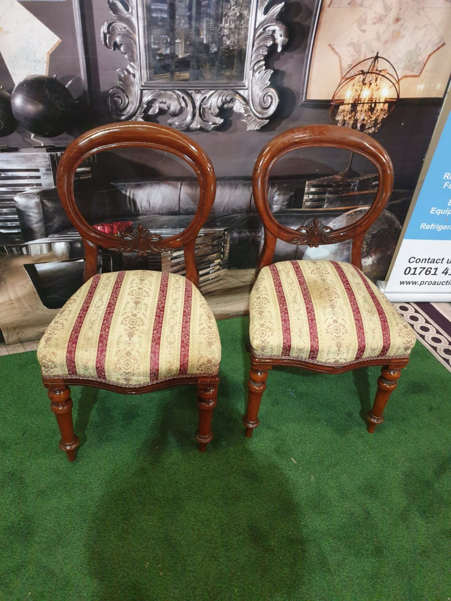 A pair of Victorian mahogany balloon back chairs. The moulded backs with carved aprons, the - Image 2 of 5