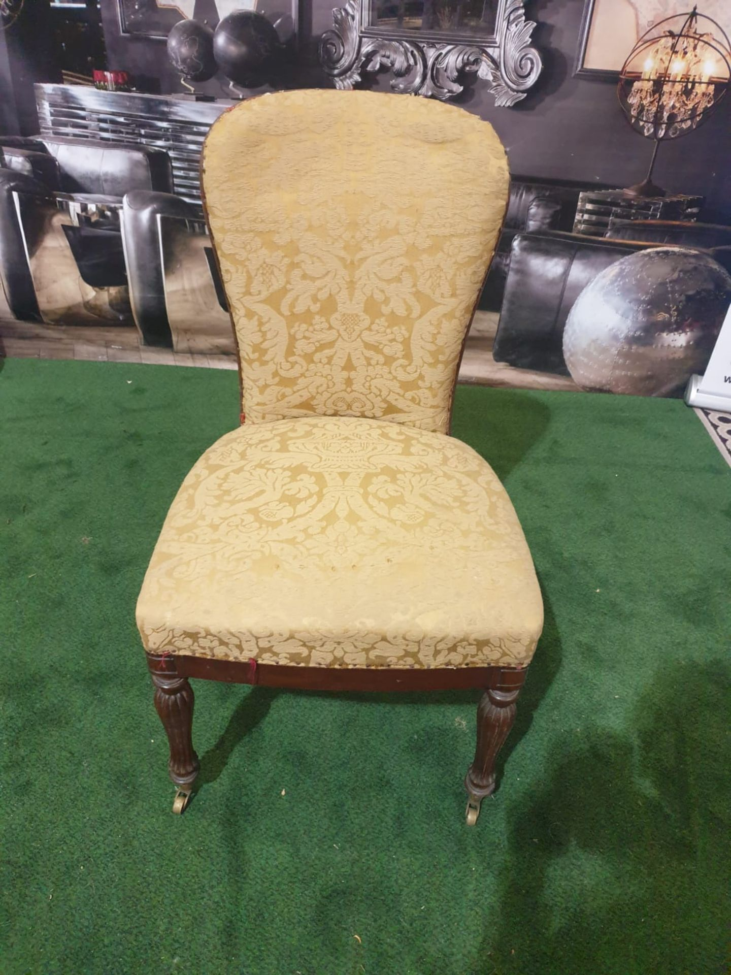 A pair of George III mahogany and upholstered side chairs Each with a rounded shaped padded back and