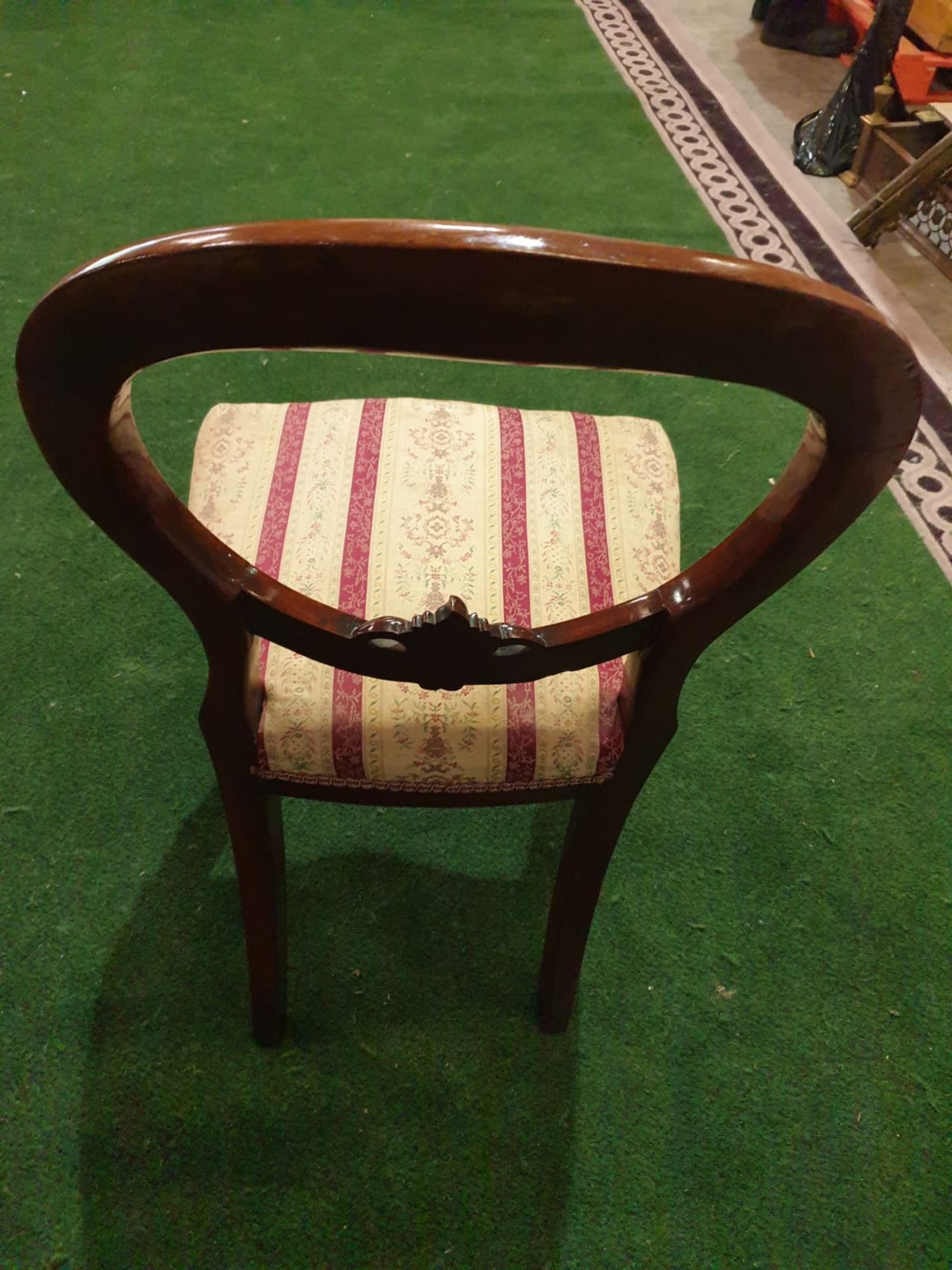 A pair of Victorian mahogany balloon back chairs. The moulded backs with carved aprons, the - Image 5 of 5