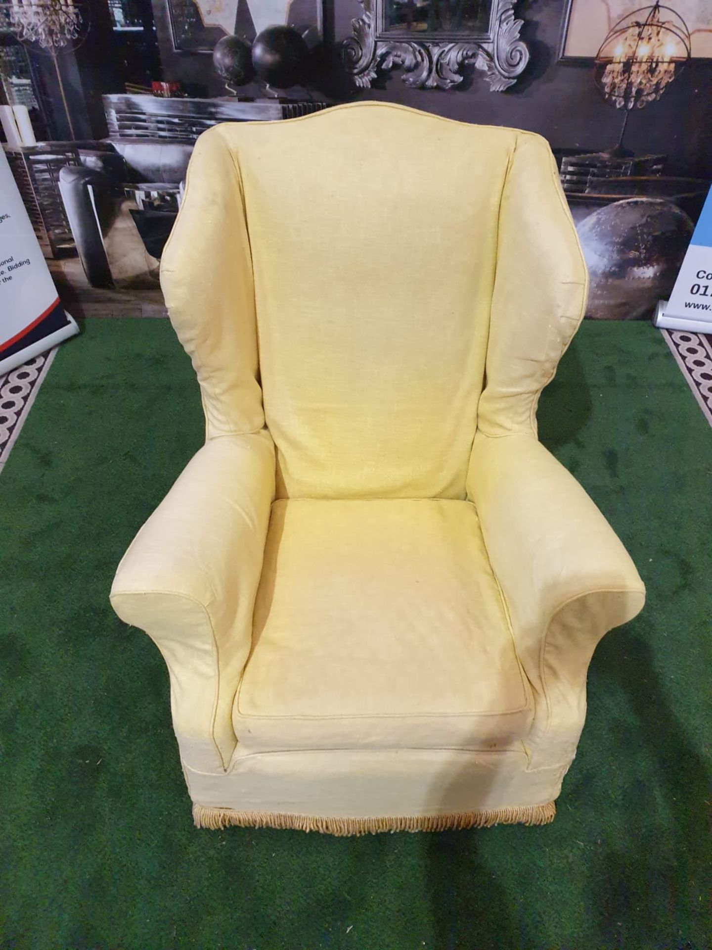 A 1940s style upholstered wing back armchair An elegant and unusual wing chair with curvaceous