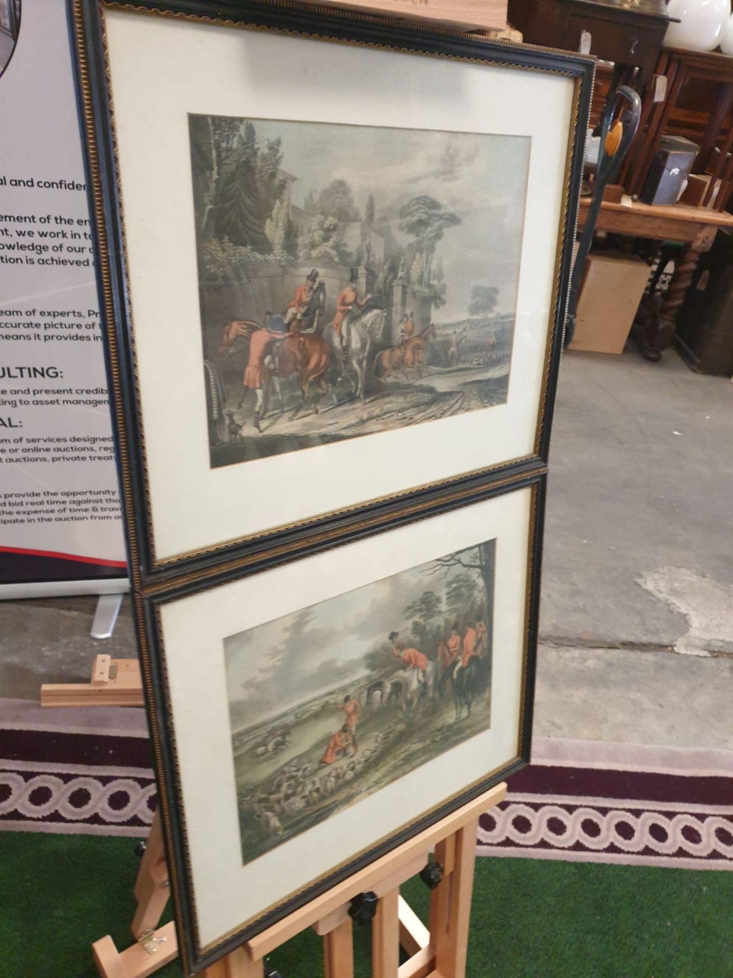 A set of 2 framed Fox hunting prints in Black & Gold frame 50 x 42cm