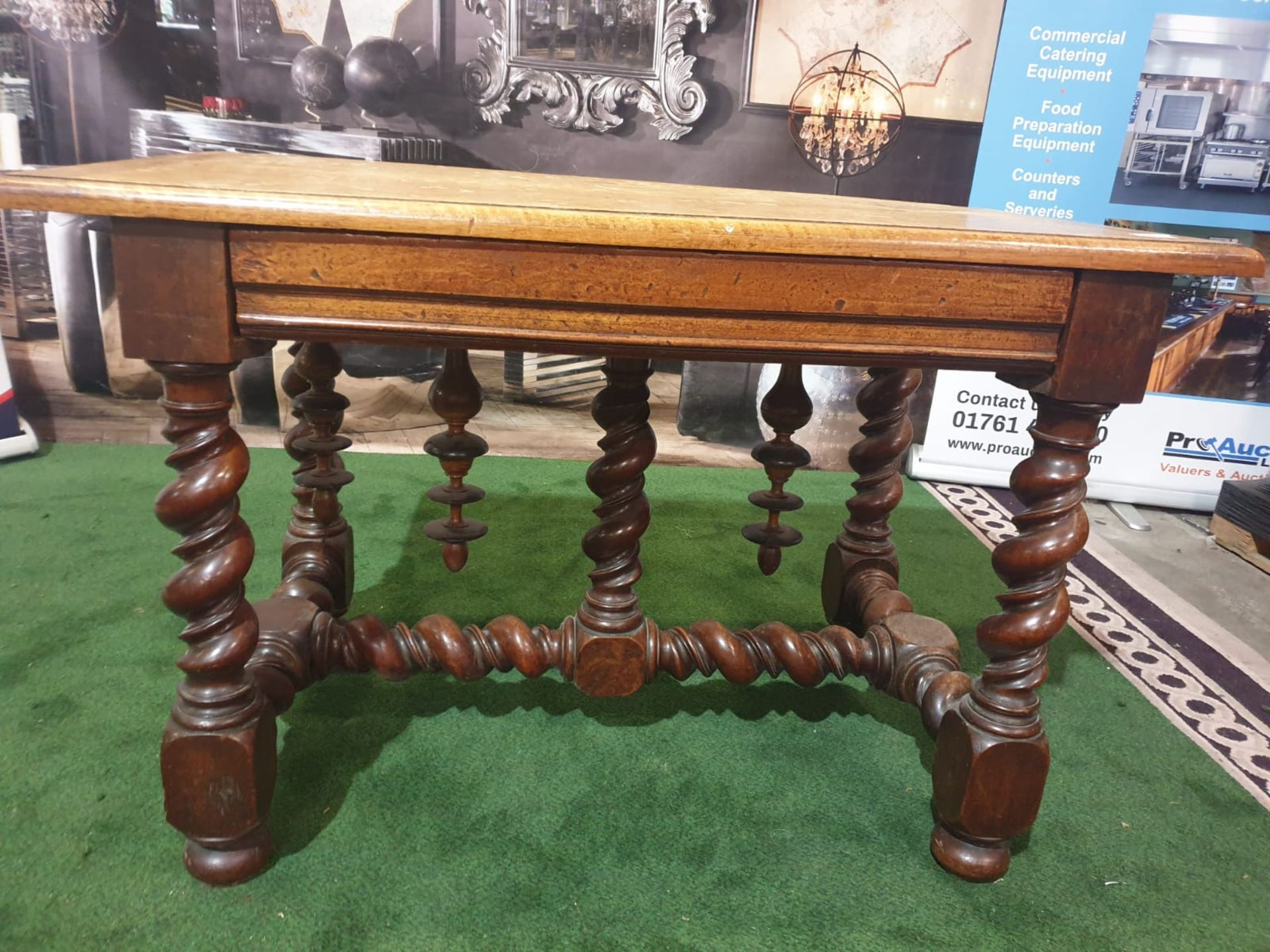 A Spanish 17th century style walnut side table. The faded cleated twin plank top above a drawer, - Image 3 of 4